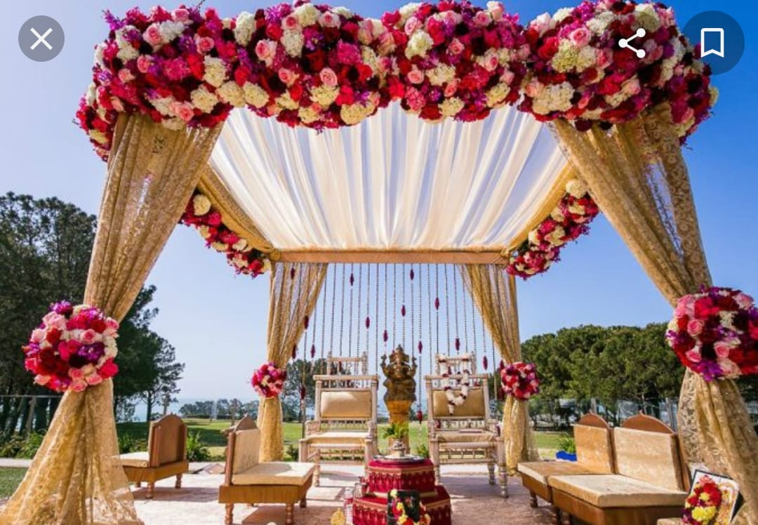 beautiful mandap decor in pastel shade decorated with roses