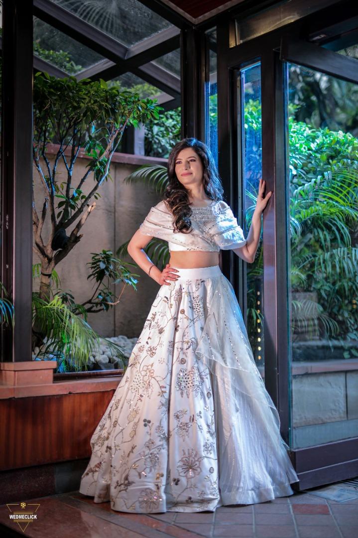 bride in a stunning white lehenga