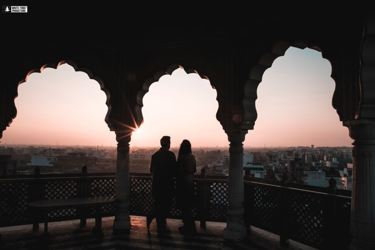 Couple Watching The Sunset Pre Wedding Picture