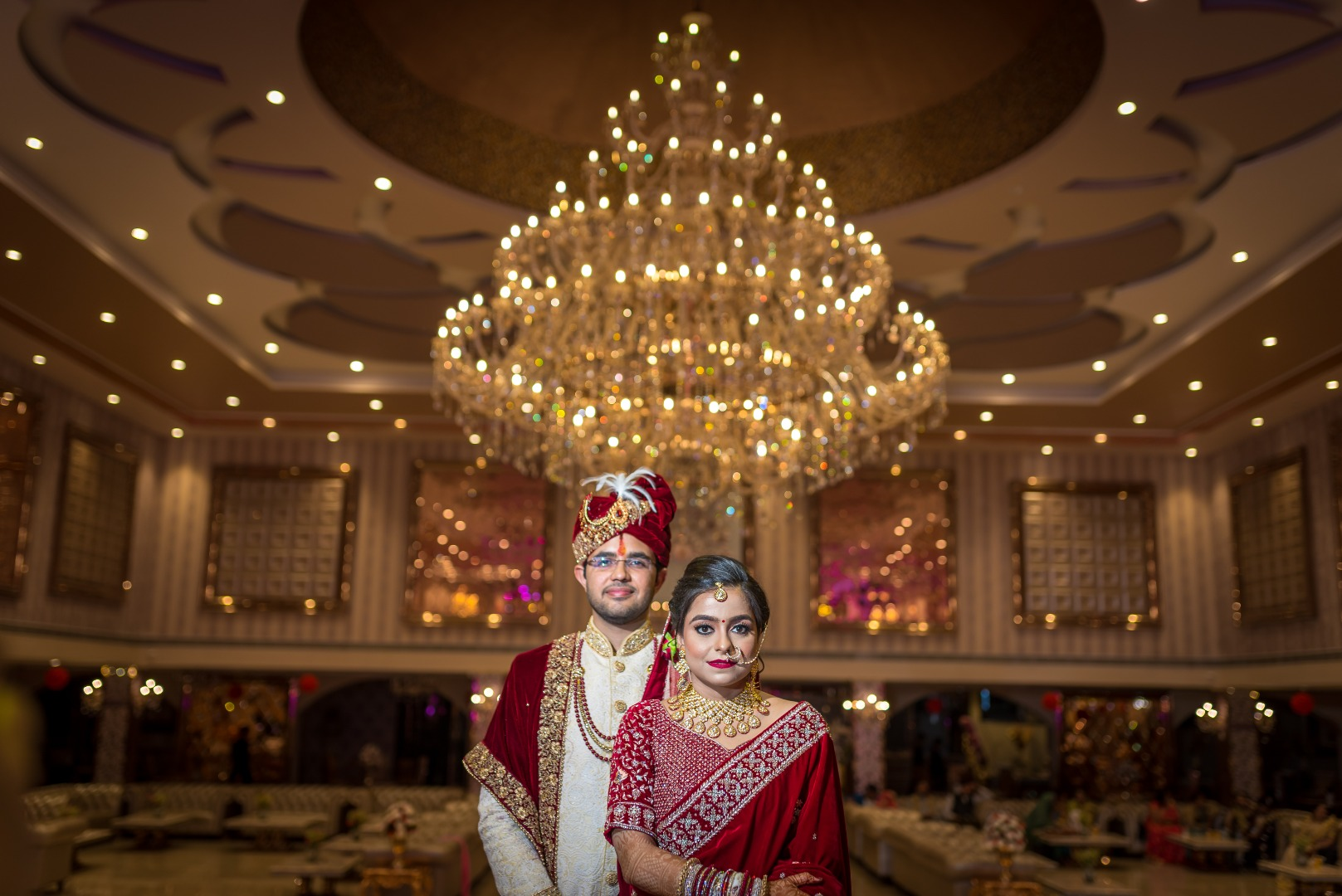 couple looks regal in red at their wedding