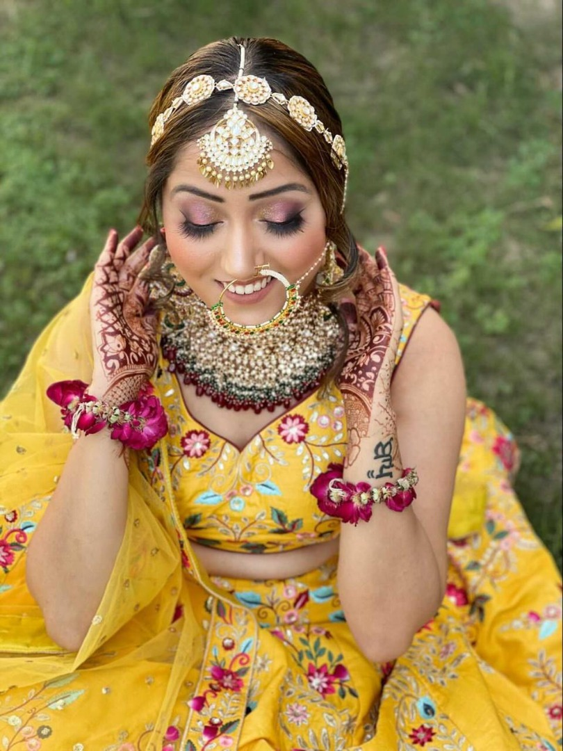 stunning bride in yellow with pink natural makeup