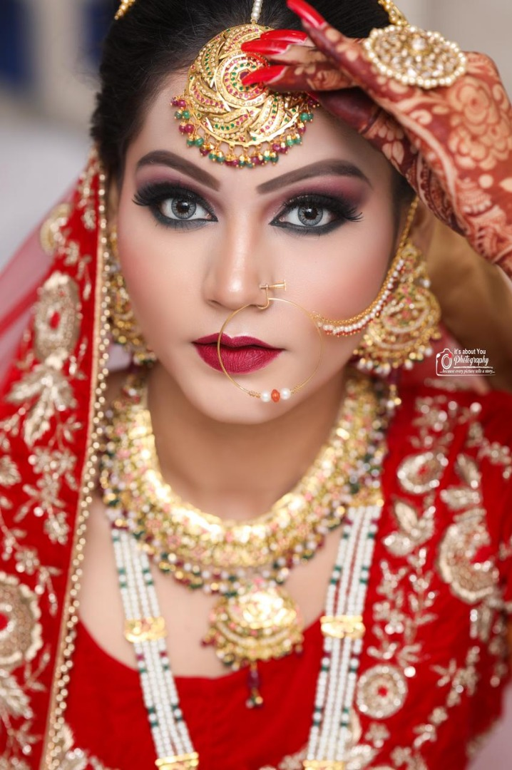 beautiful bridal shot of the bride with stunning makeup and bold red lip