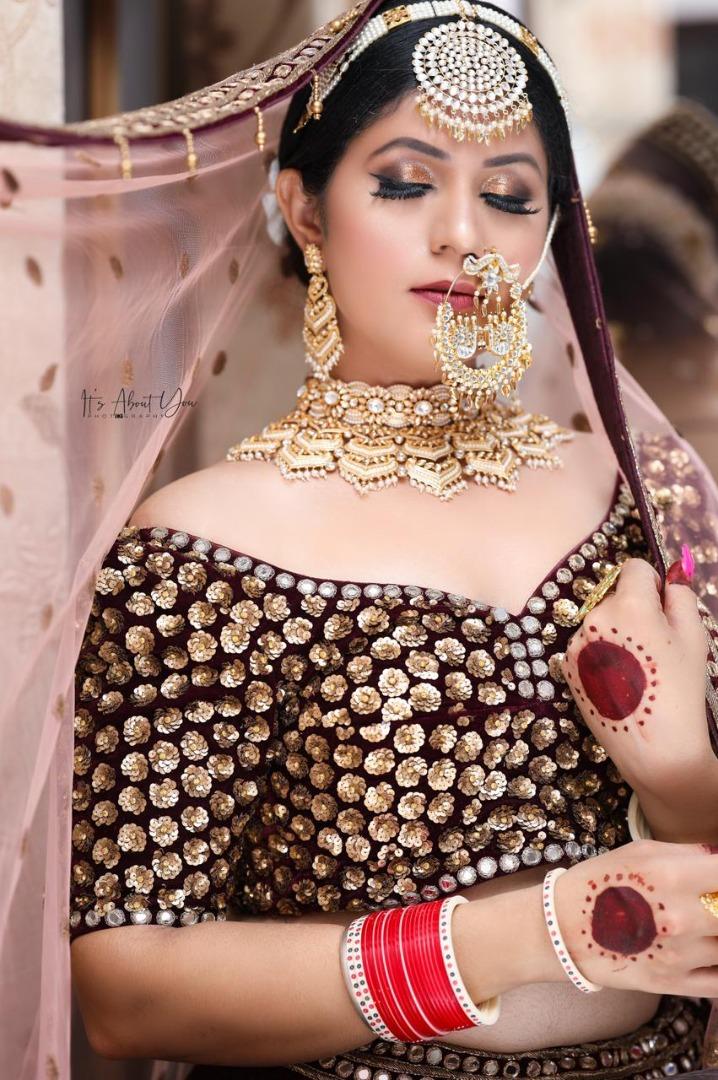 bride in off shoulder lehenga