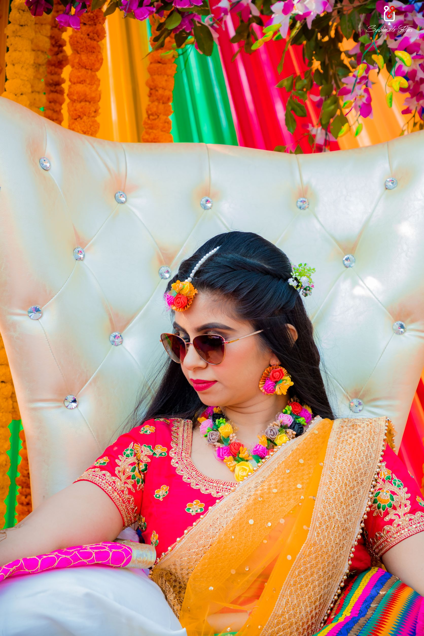 beautiful bride in floral jewellery and sunglasses