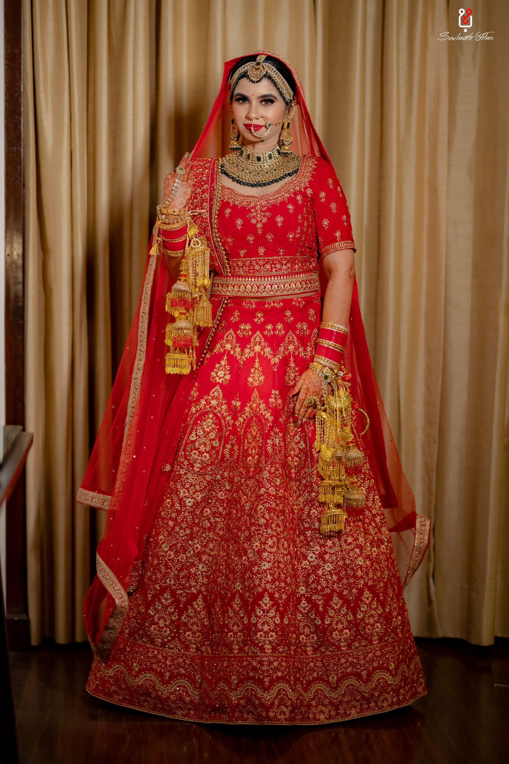 beautiful bride in red bridal lehenga