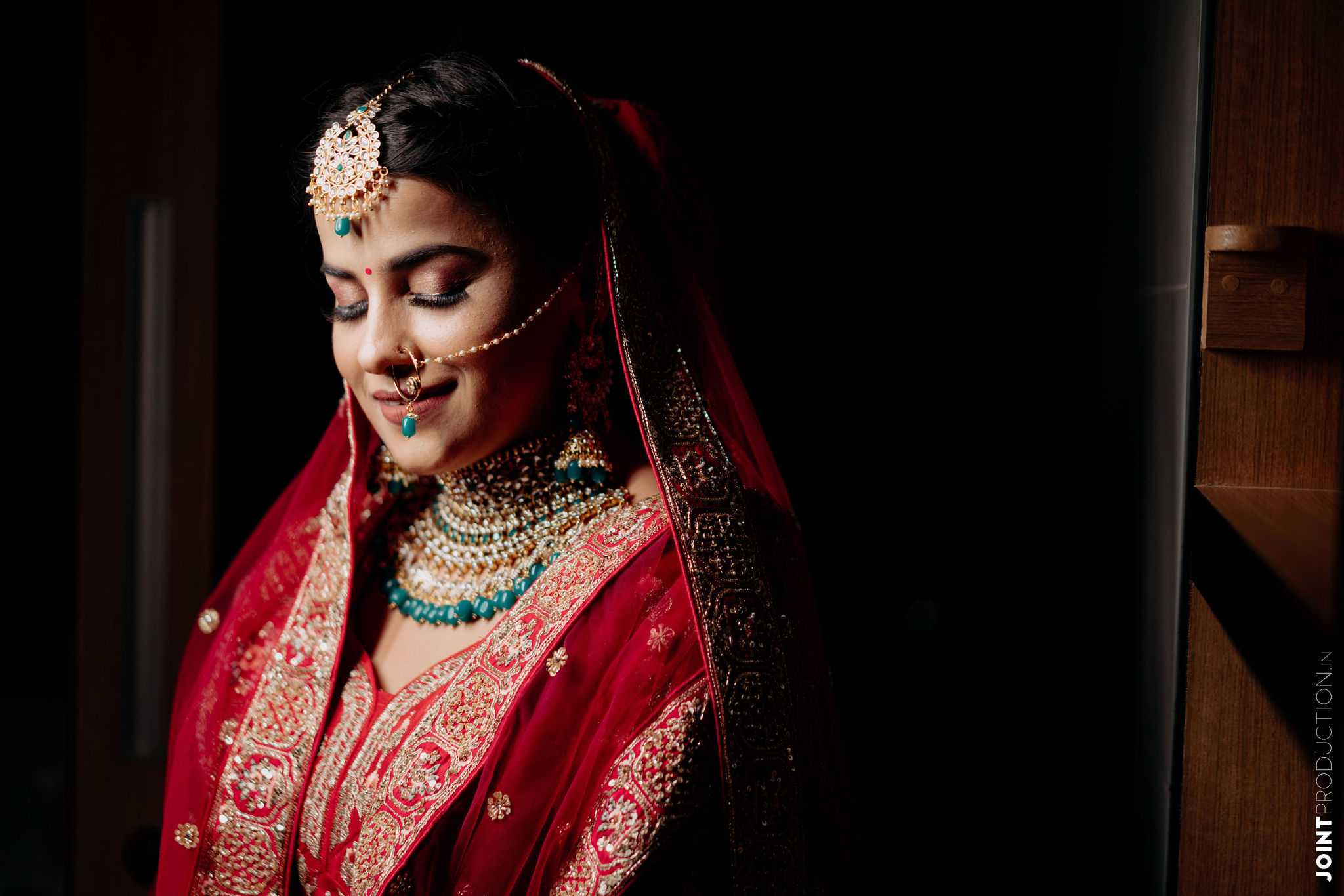 blushing bride in gold bridal jewellery