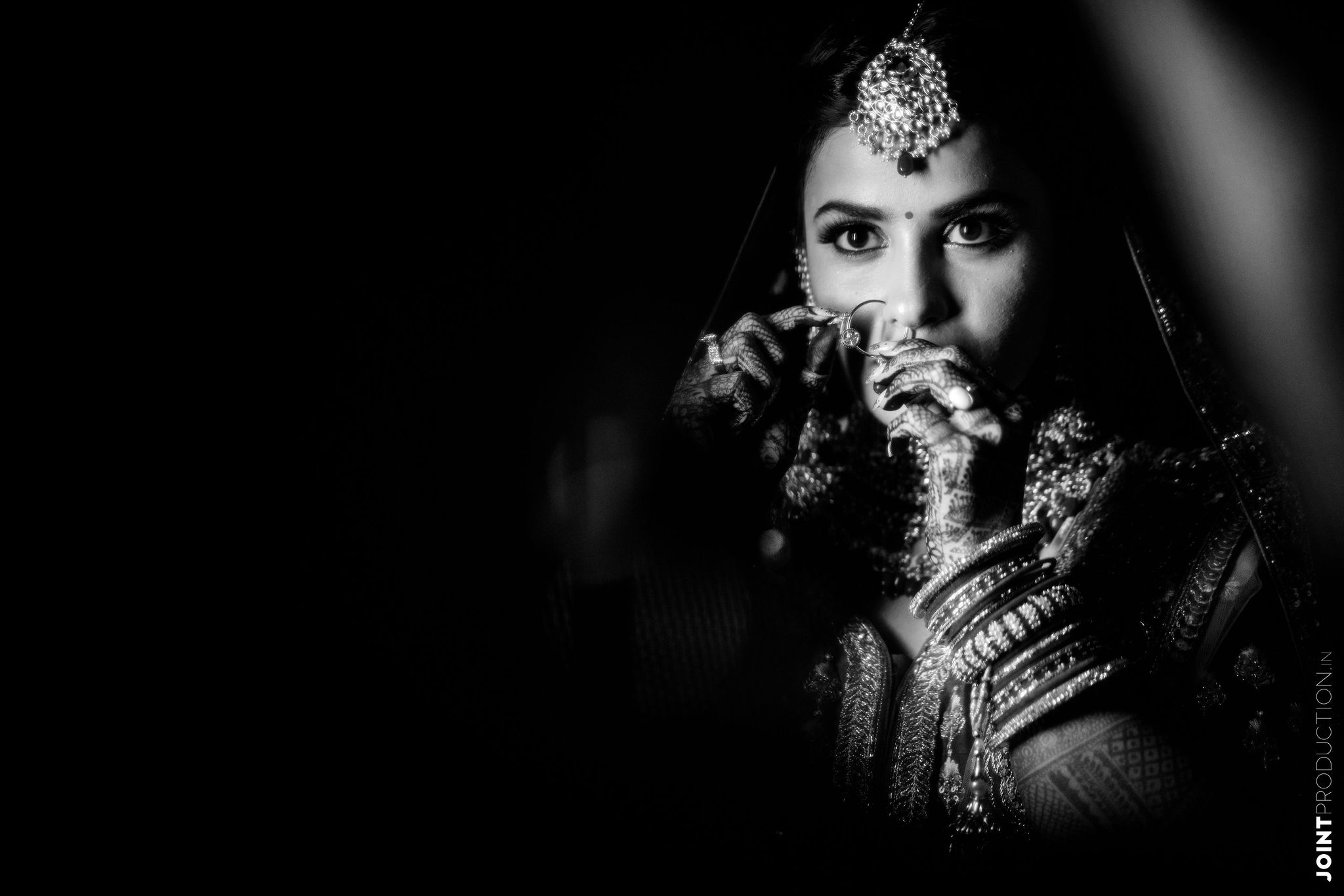 bnw shot of the bride with her bridal nath