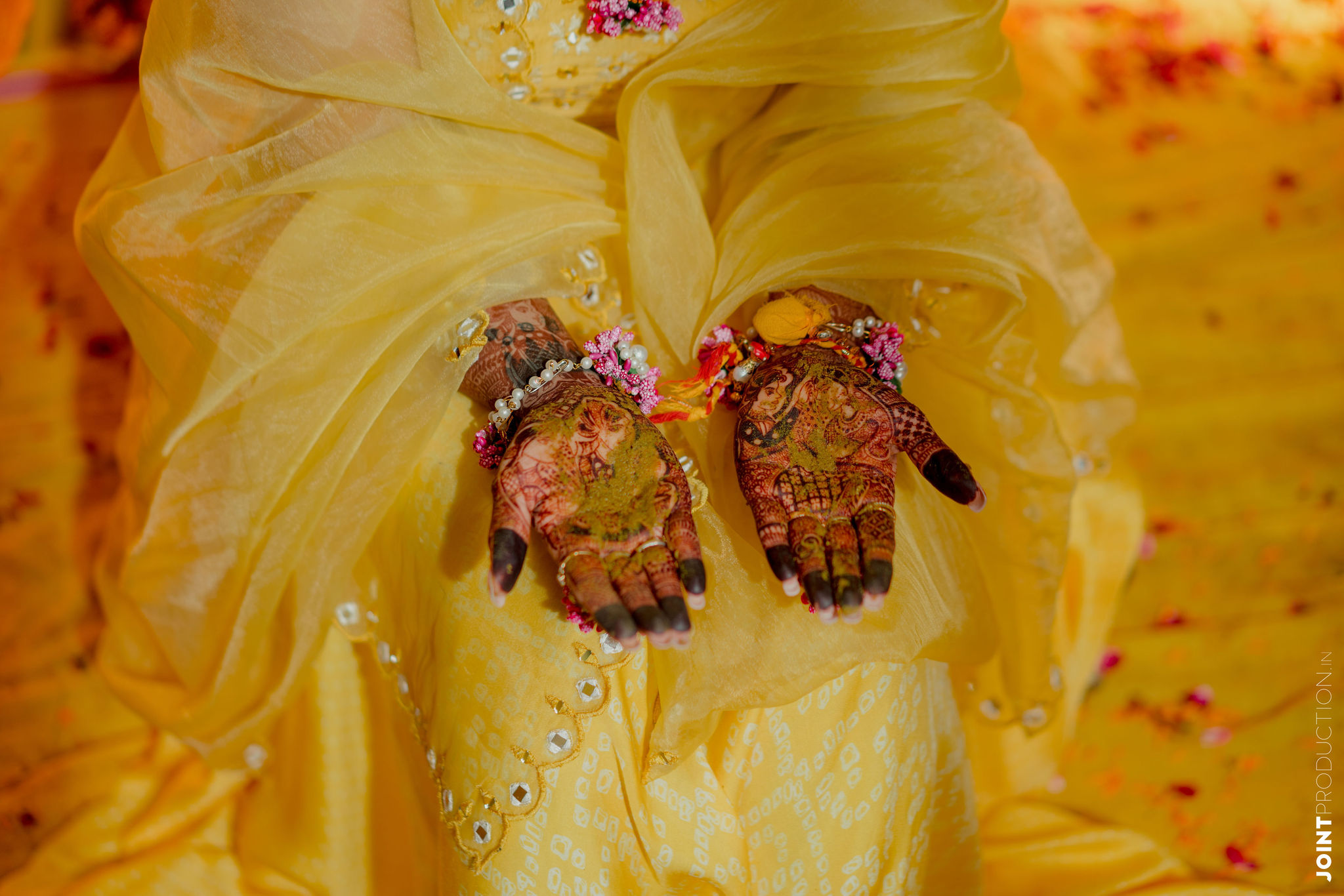 bridal hands painted with haldi