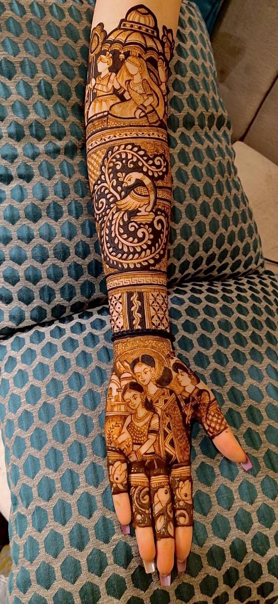 bridal mehendi with couple's illustration