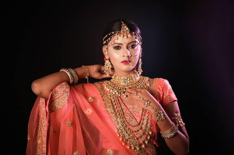 bride in layered bridal jewellery