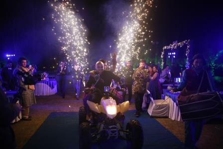 bride and groom entry in sangeet