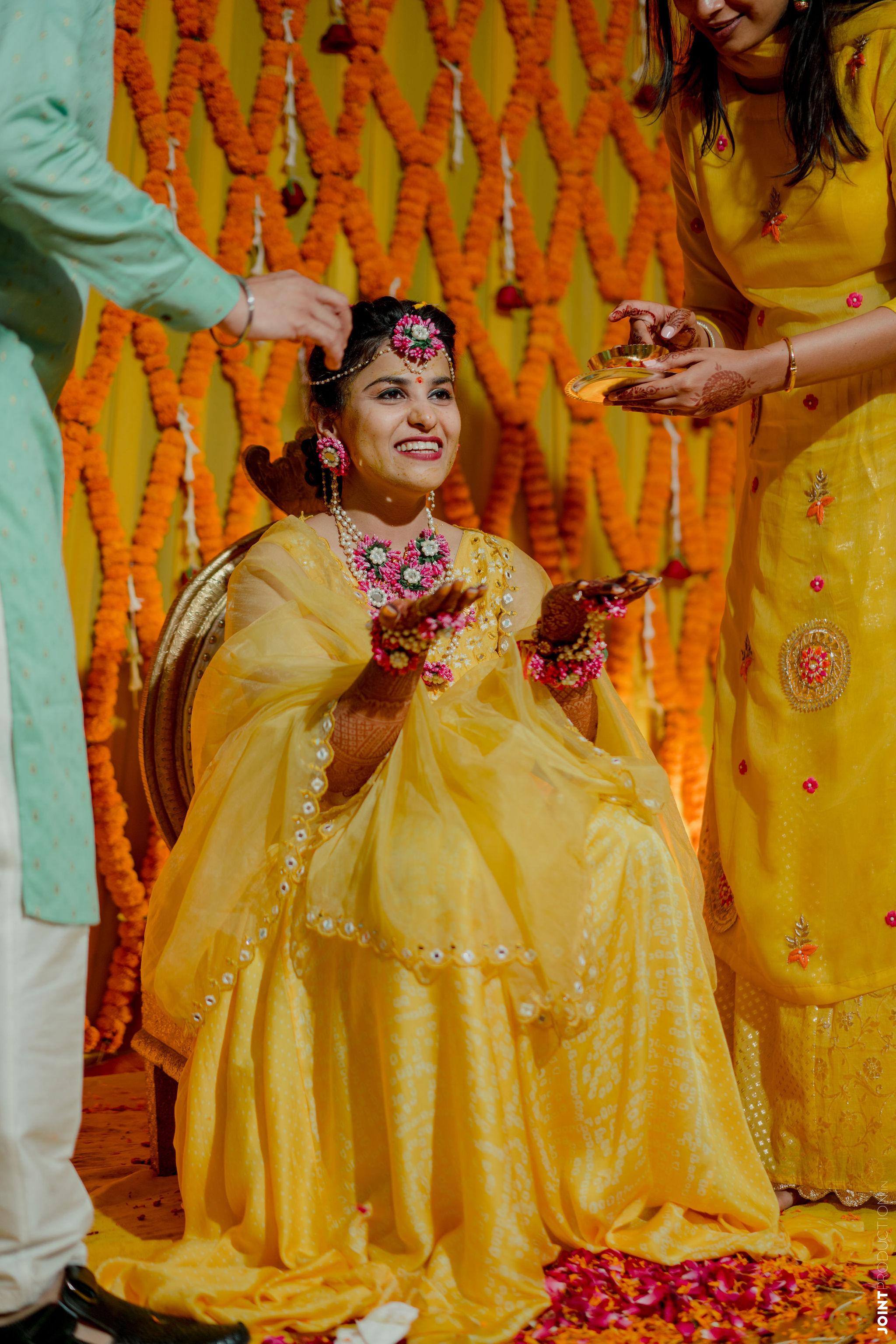 bride at her haldi ceremony