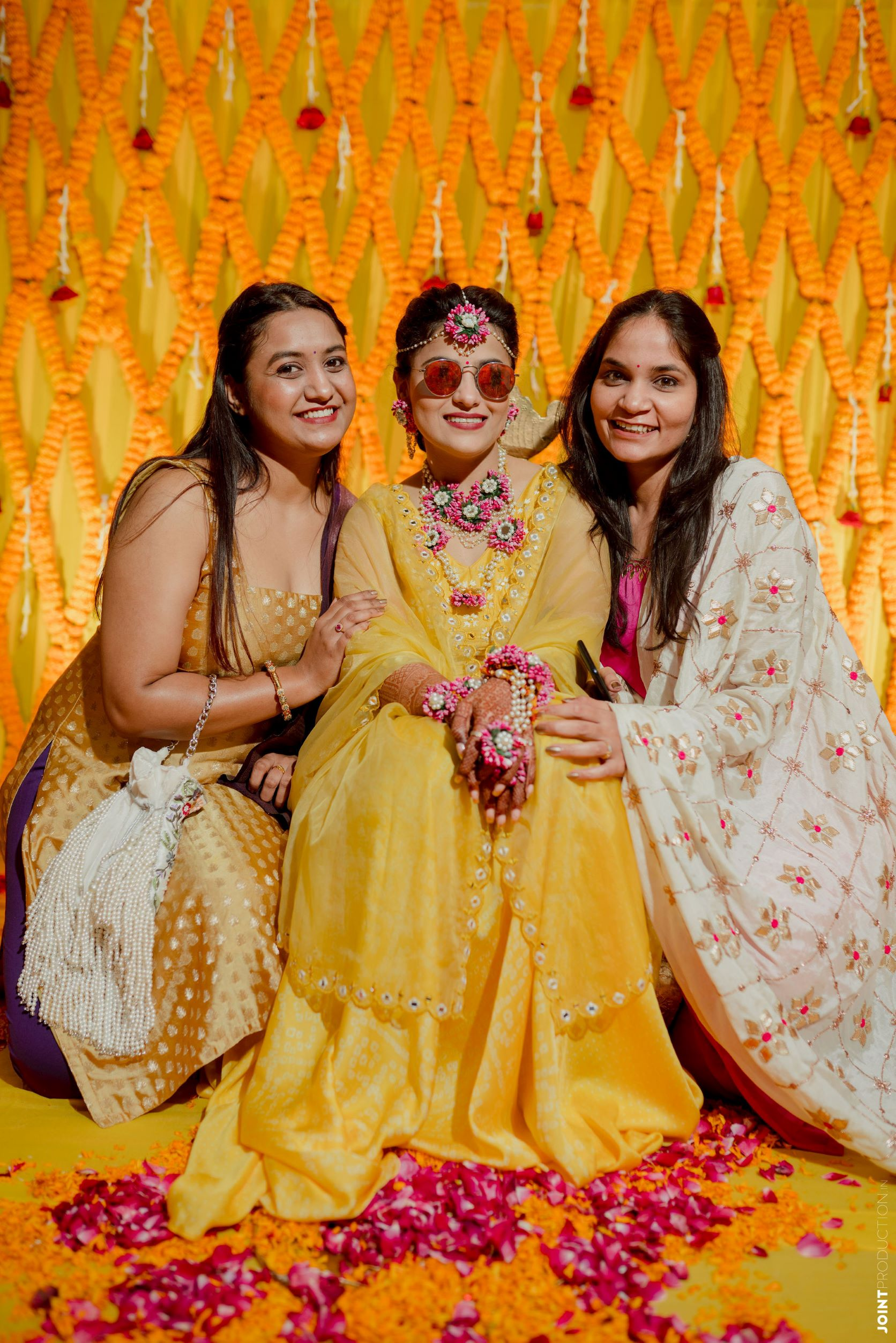 bride at her haldi with her girl gang