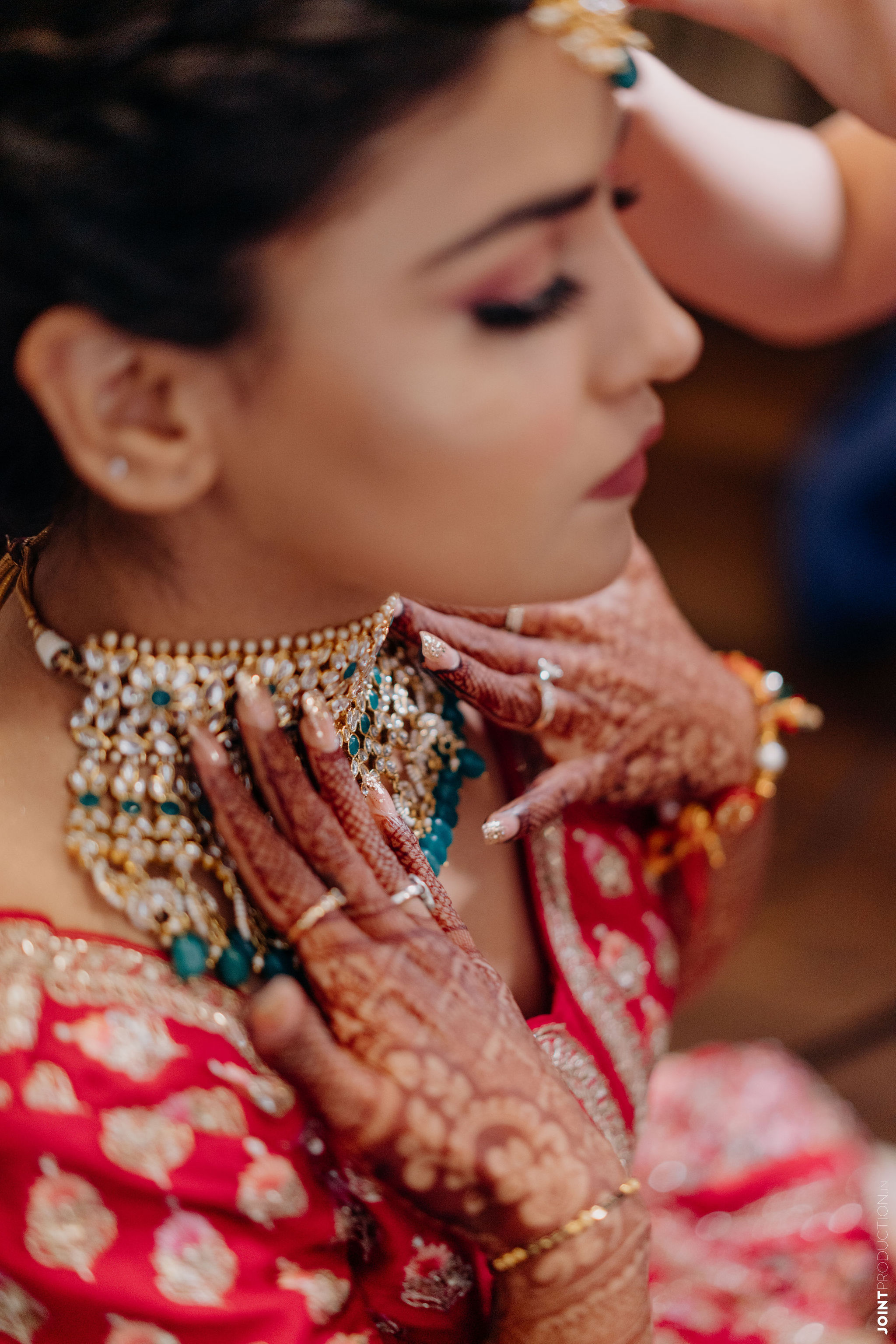 bride in blue stoned bridal jewellery