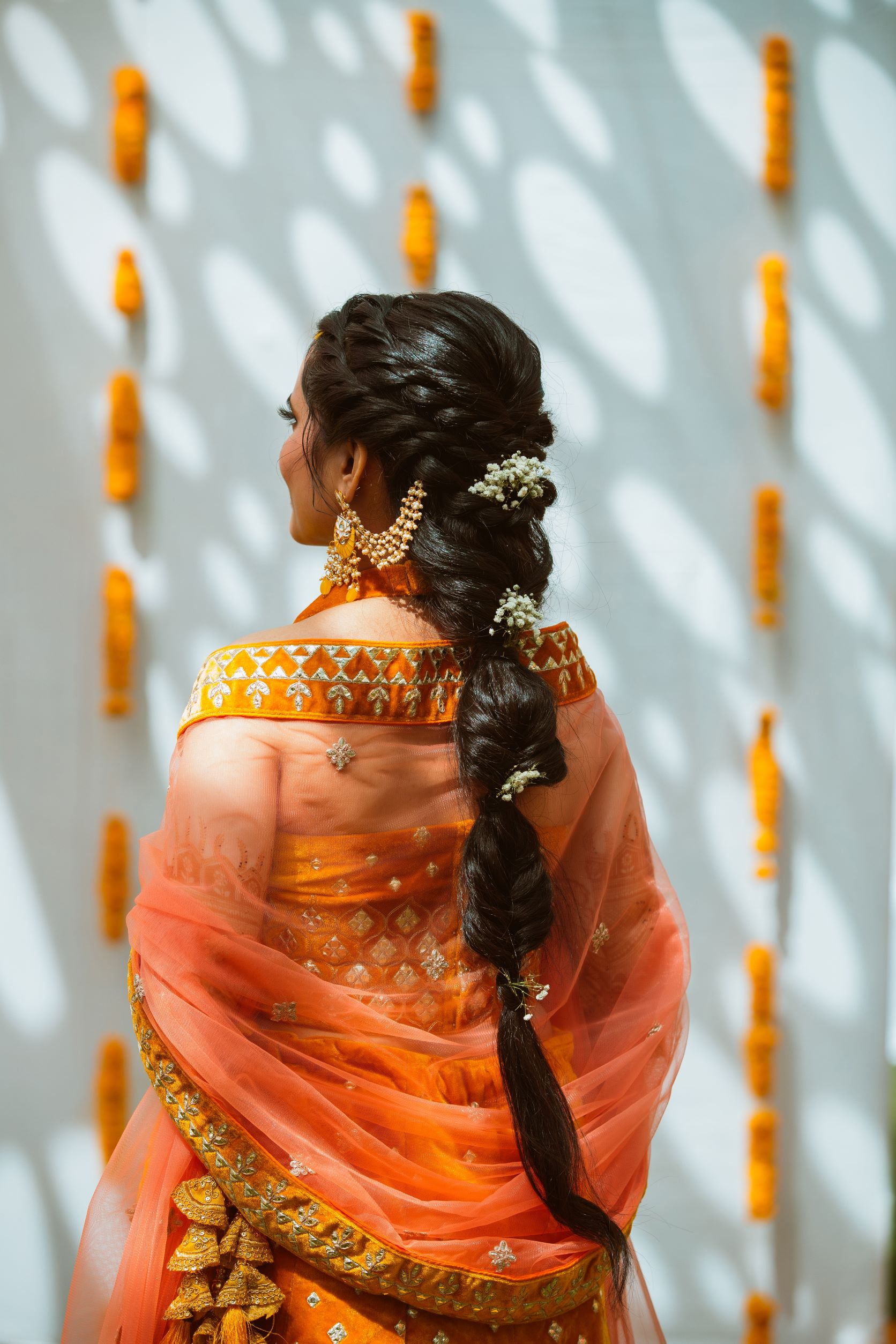 bride in braided hairstyle with floral accessories