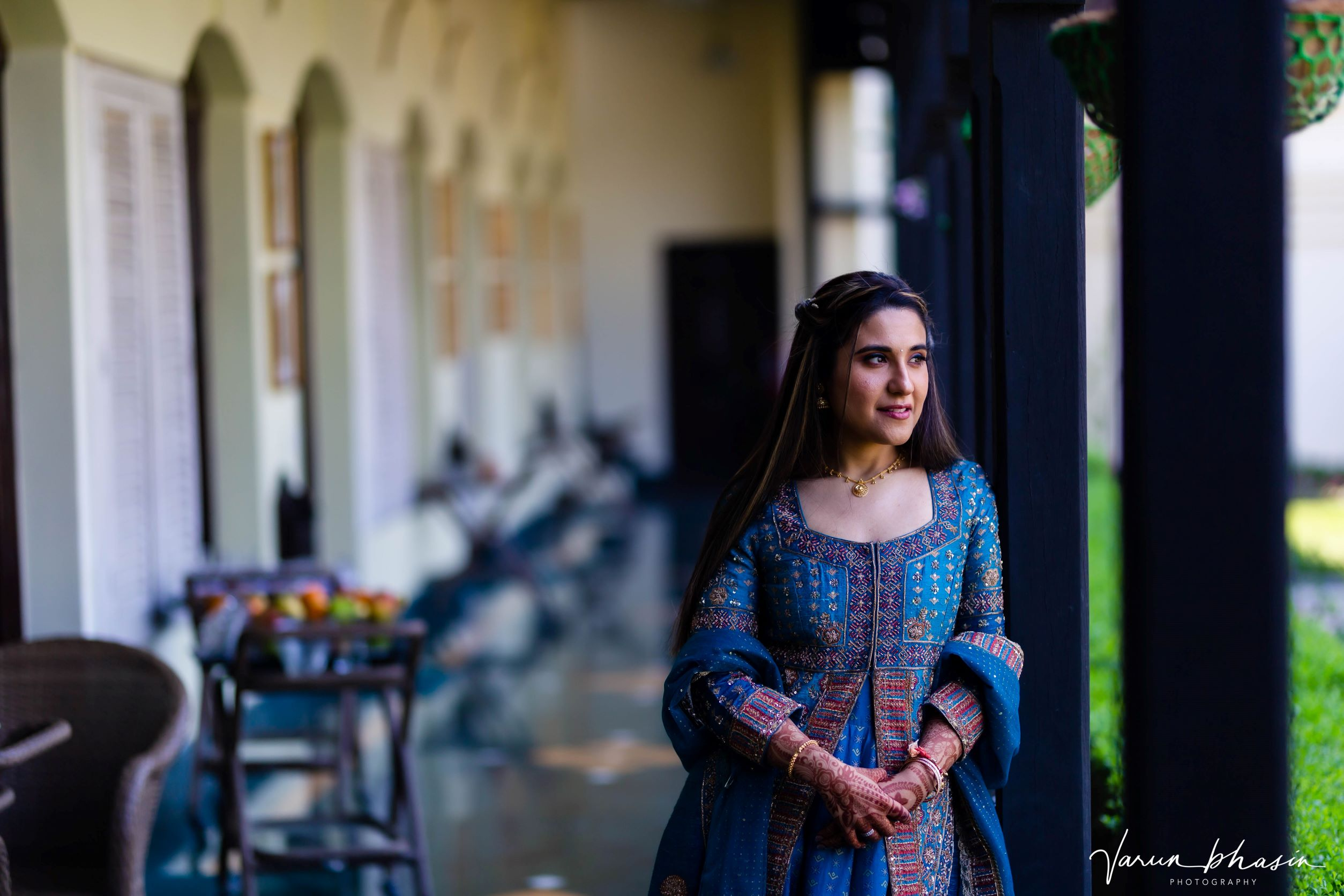 bride in embroidered blue suit