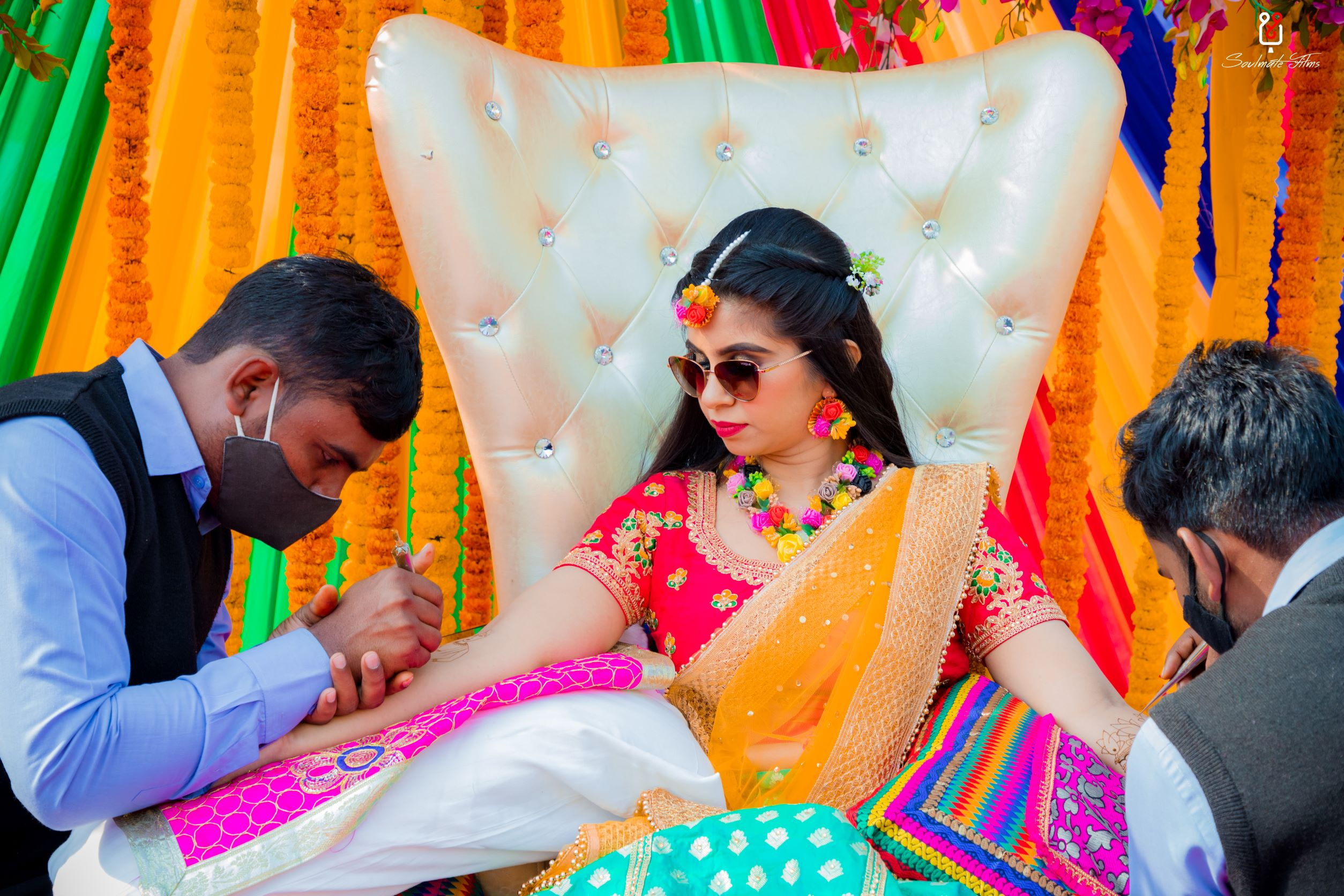 bride in floral jewellery and sunglasses