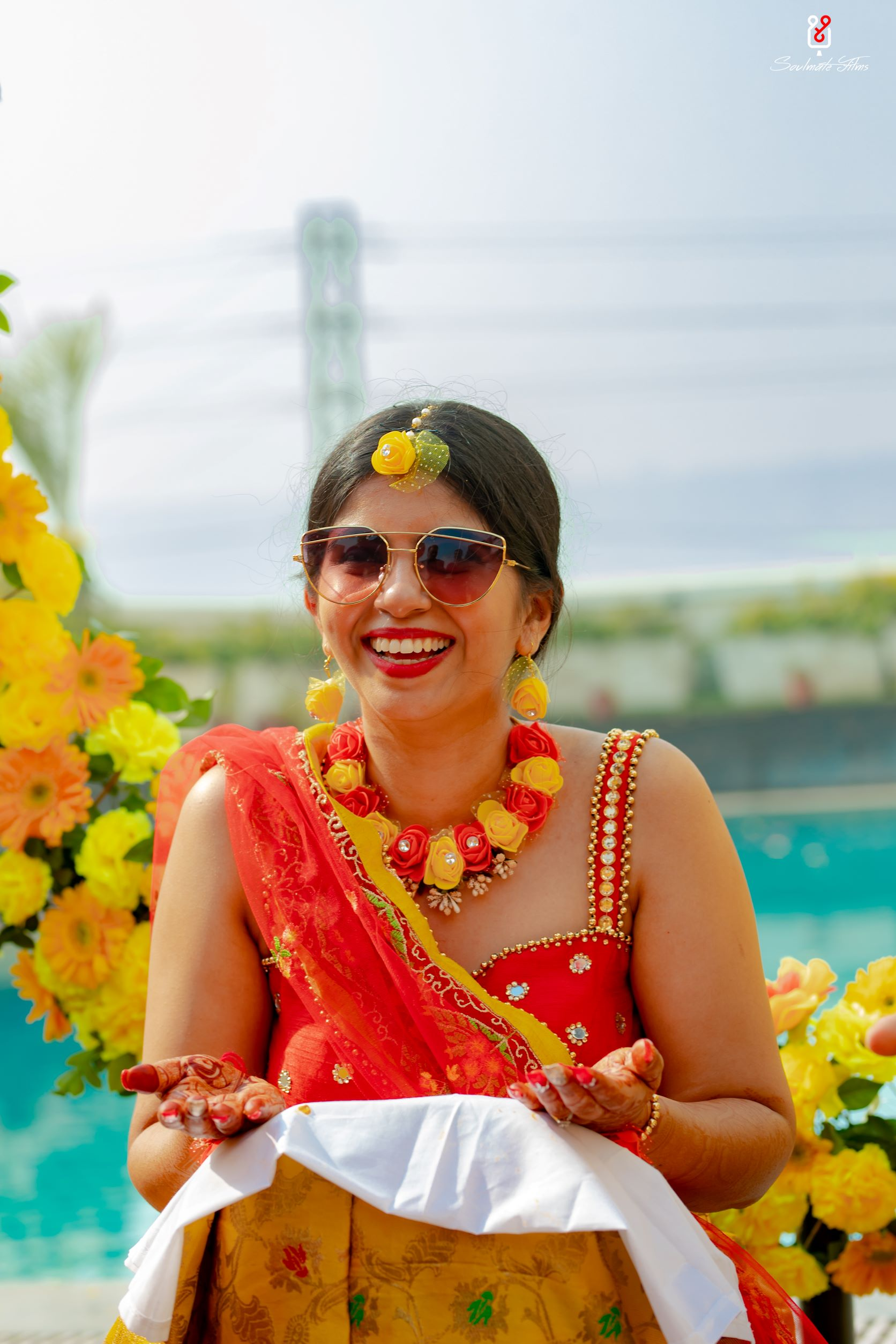 bride in floral jewellery for haldi
