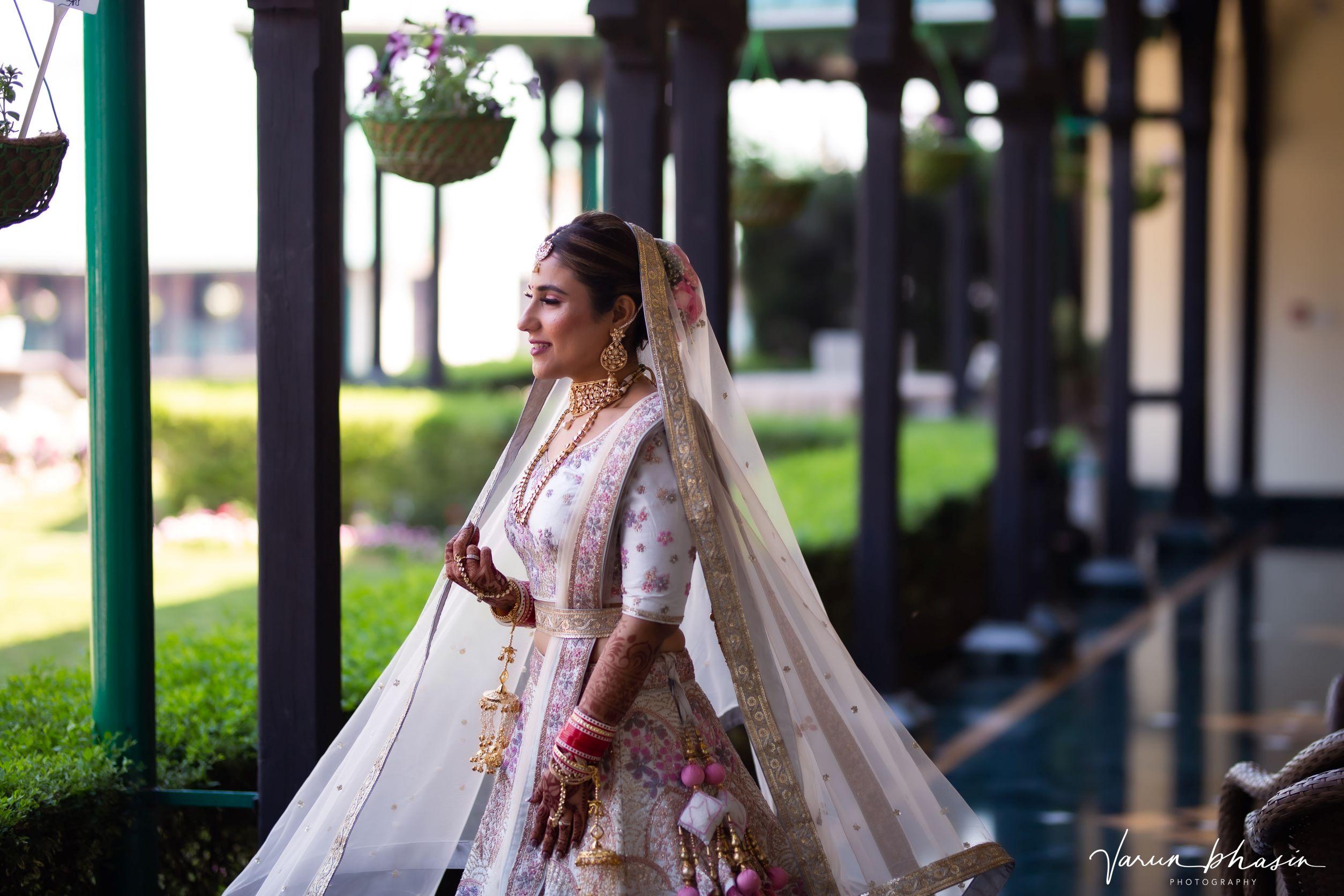 bride in floral white bridal lehenga