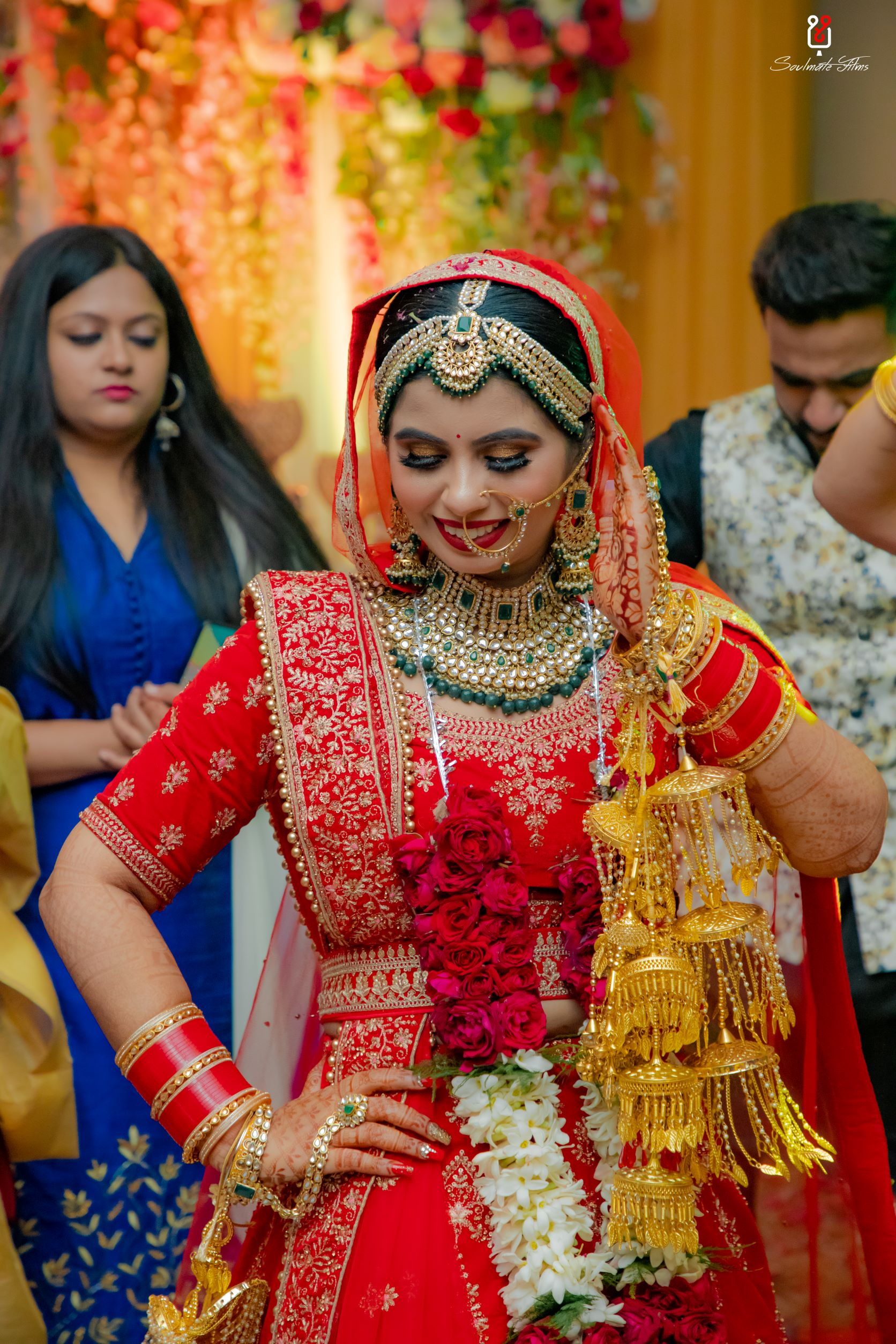 bride in gold bridal kalire and red chooda