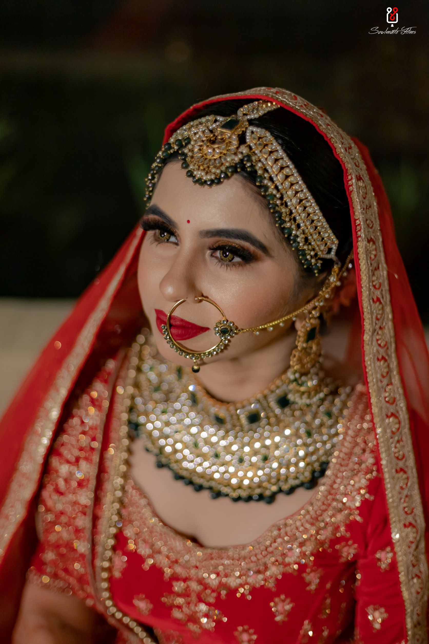 bride in gold eye makeup and bold red lip