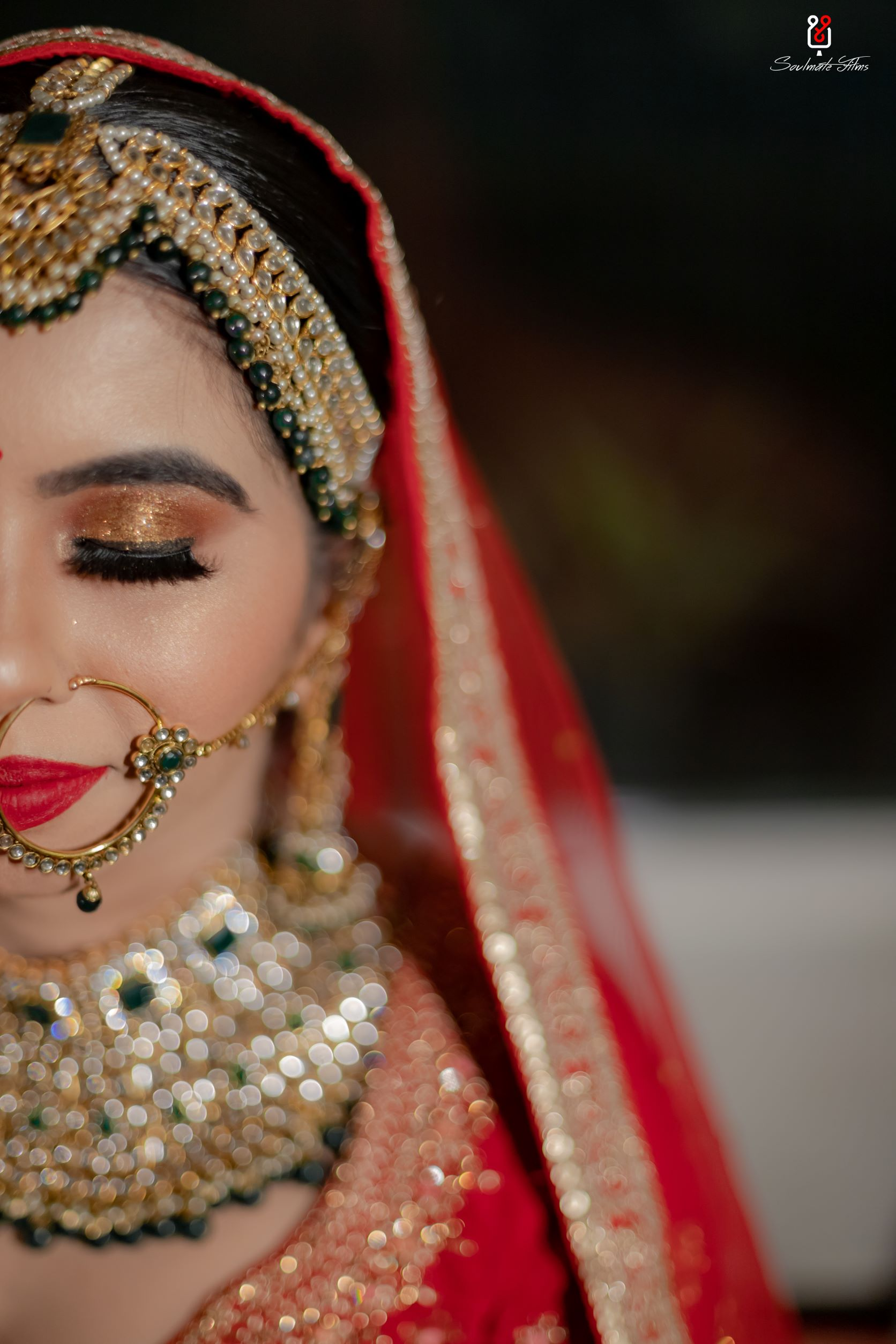 bride in gold eye makeup with bold red lip