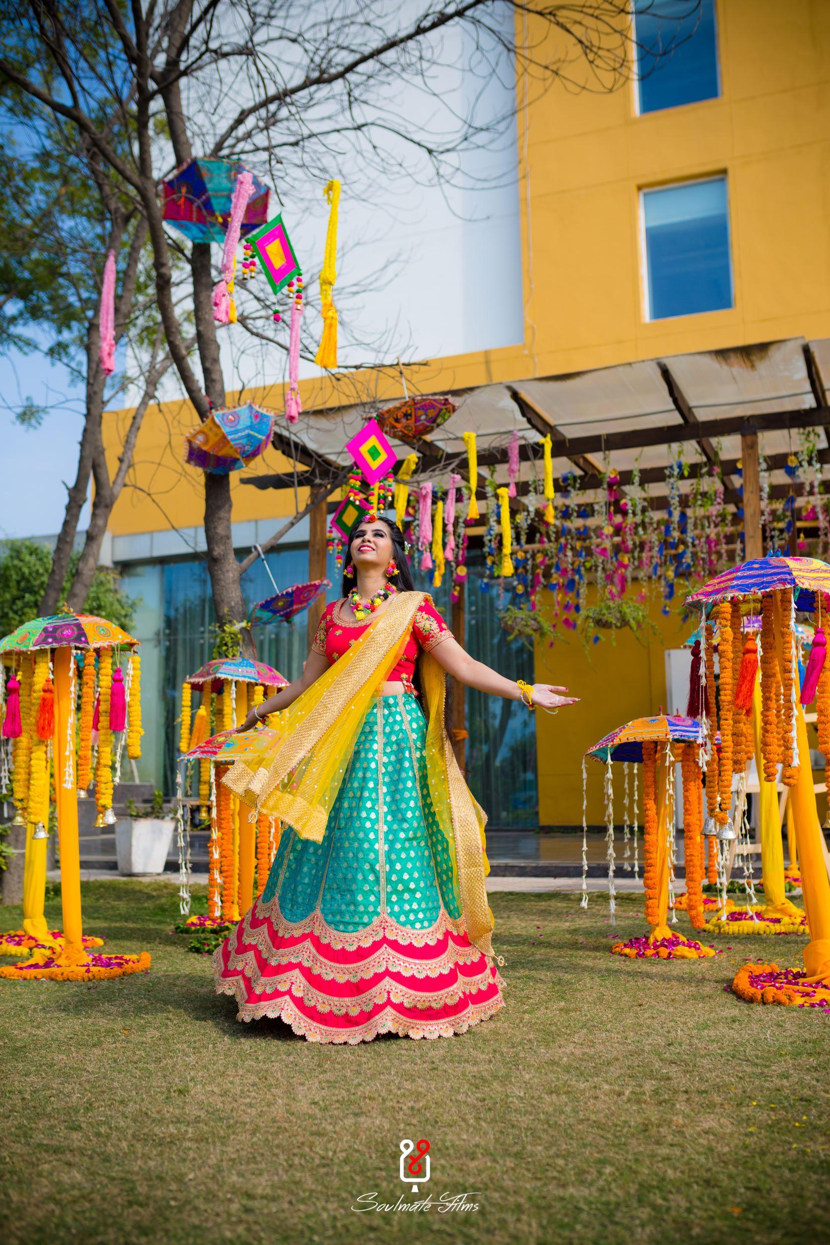 bride in multi coloured lehenga for mehendi
