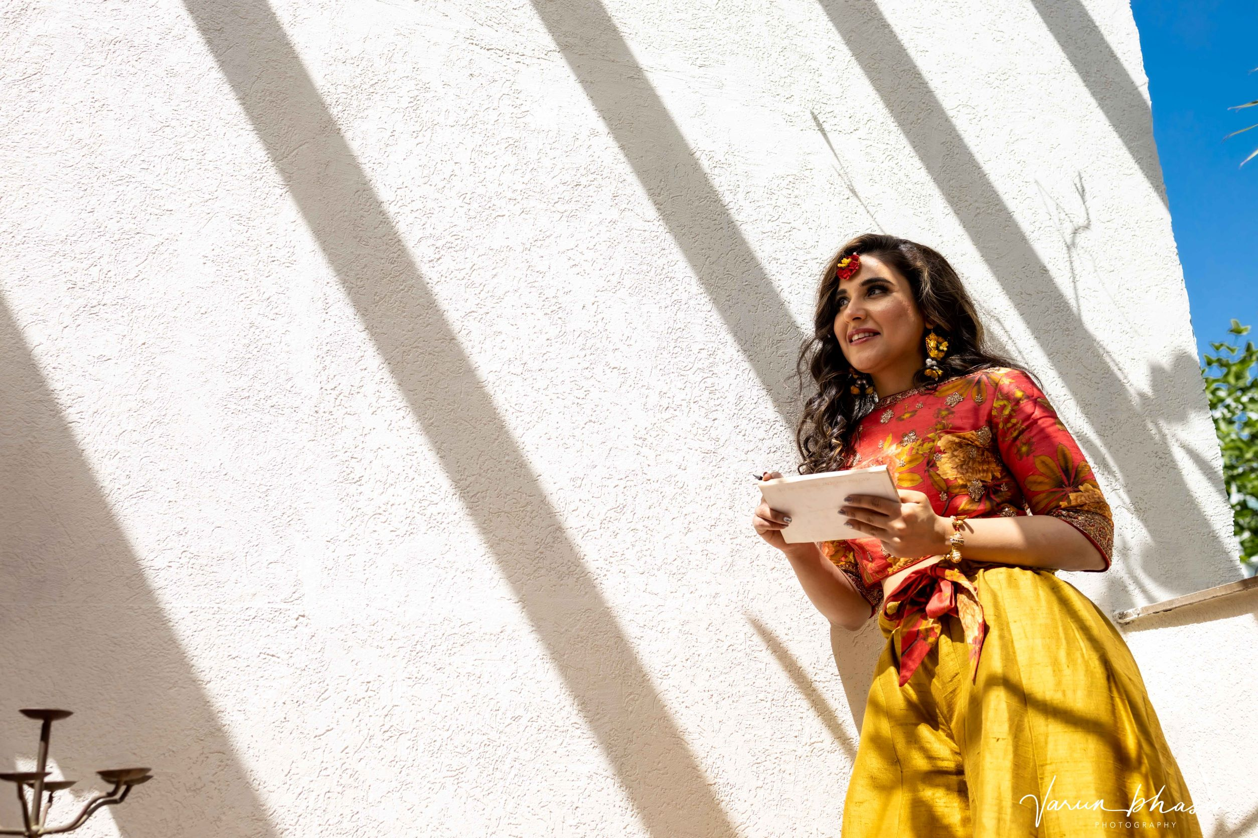 bride in orange and yellow outfit for mehendi