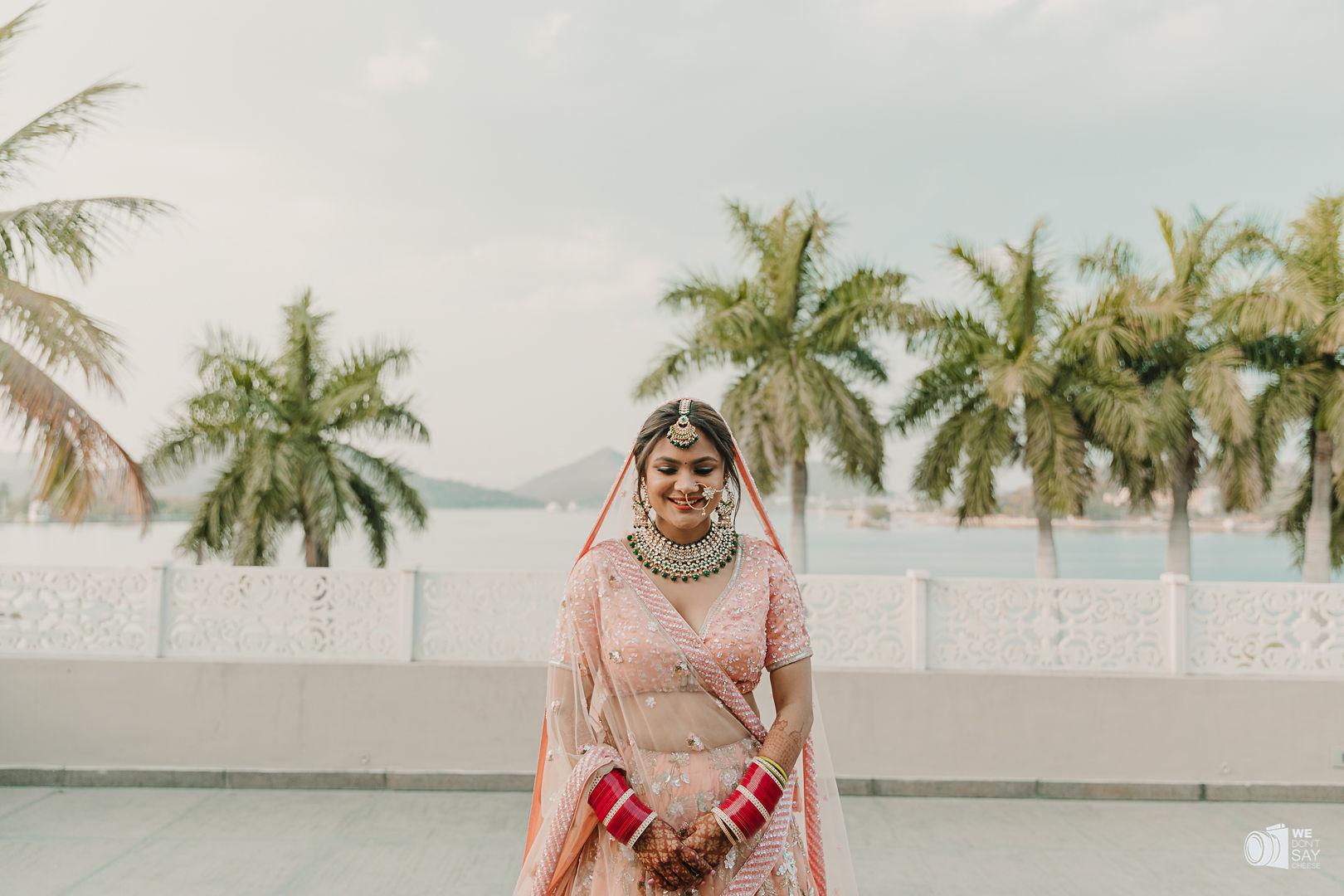 bride in peach bridal lehenga