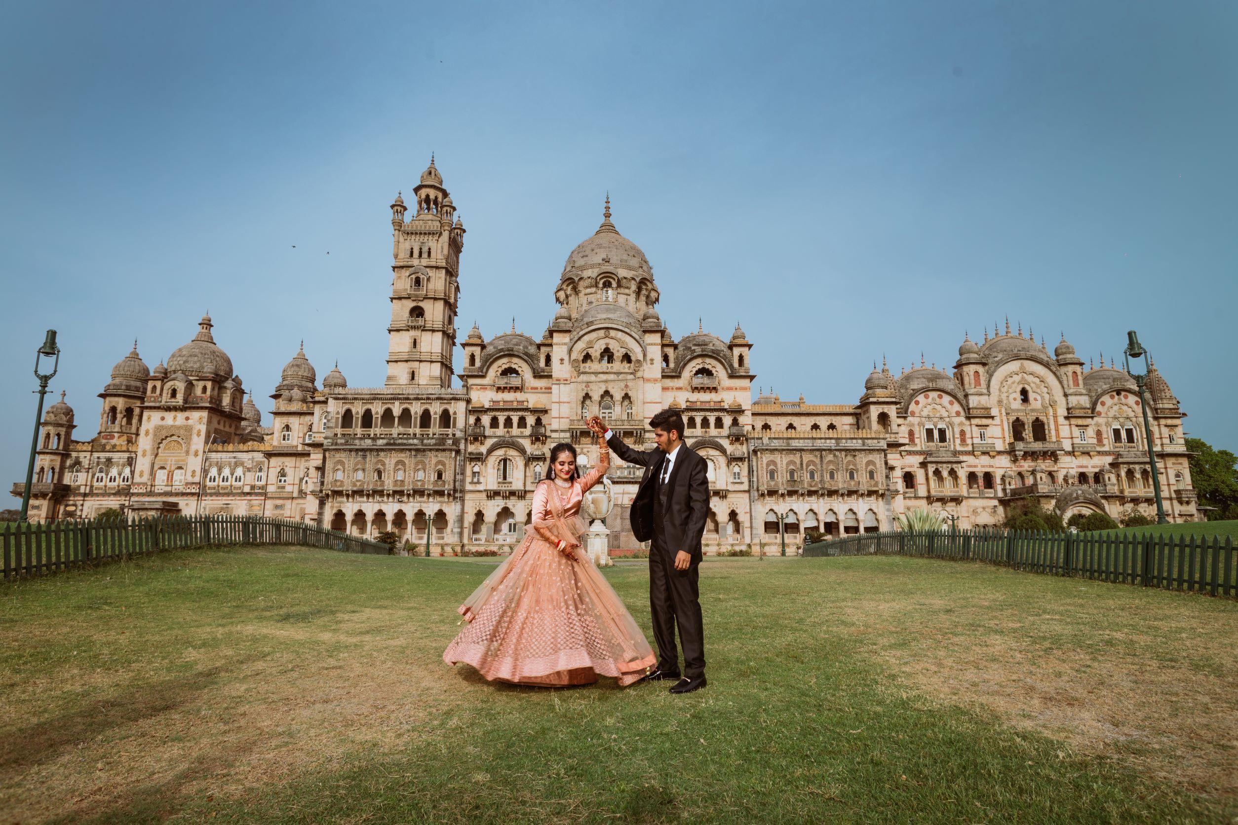 bride in peach lehenga twirls with her groom
