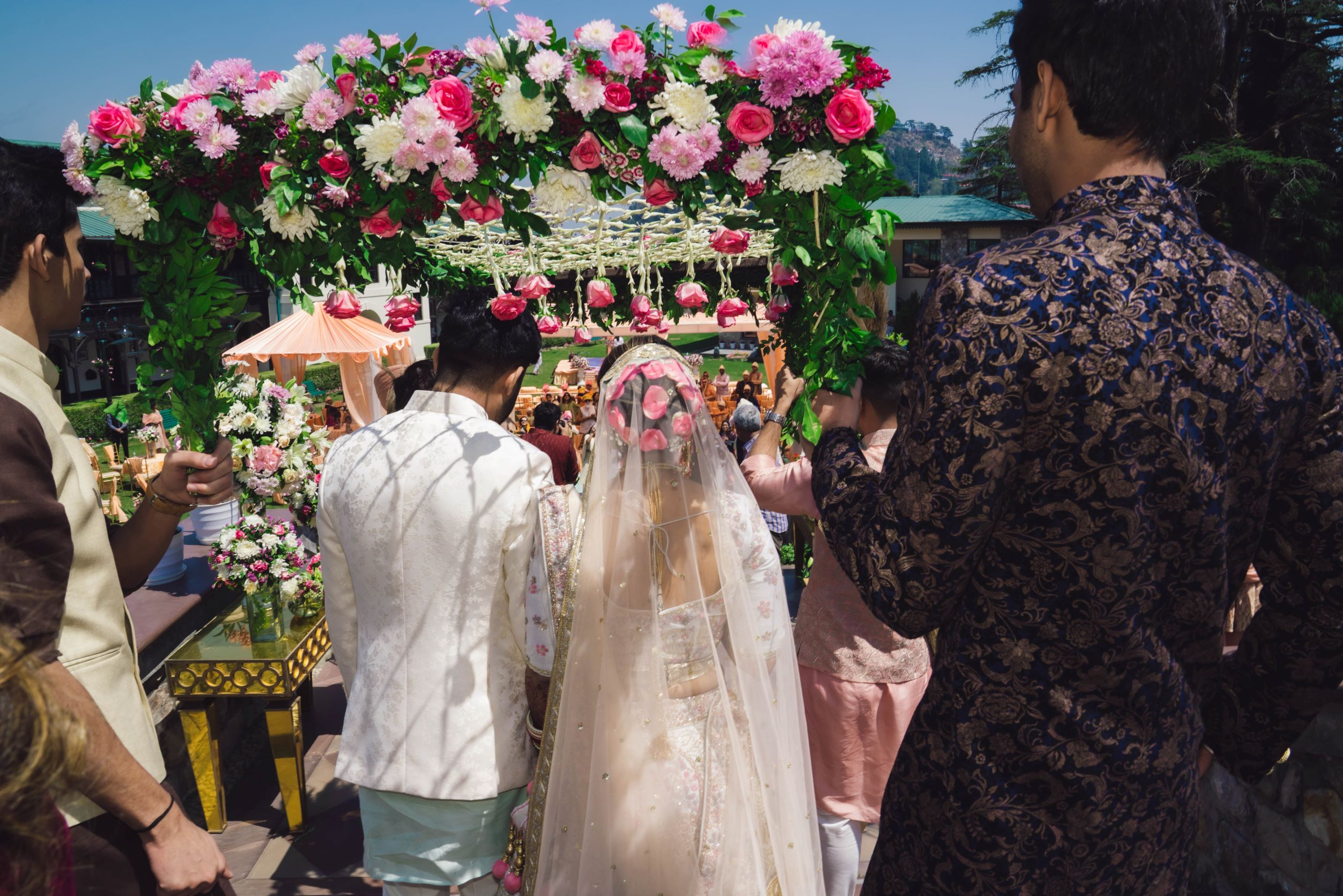 bride in pink floral bridal bun