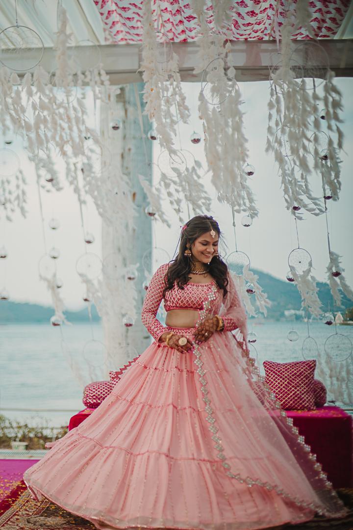 bride in pink lehenga for engagement