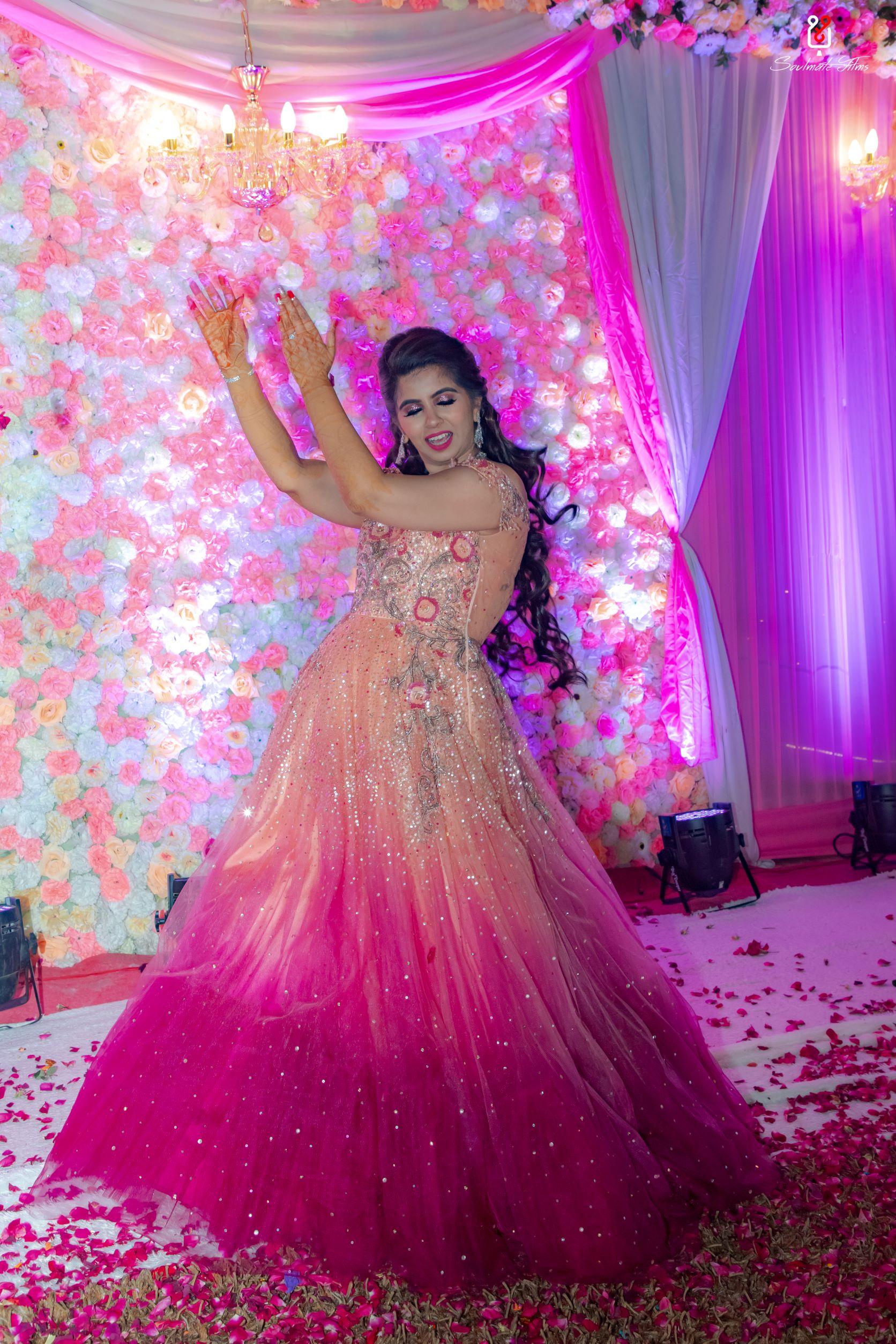 bride in pink ombre gown dancing