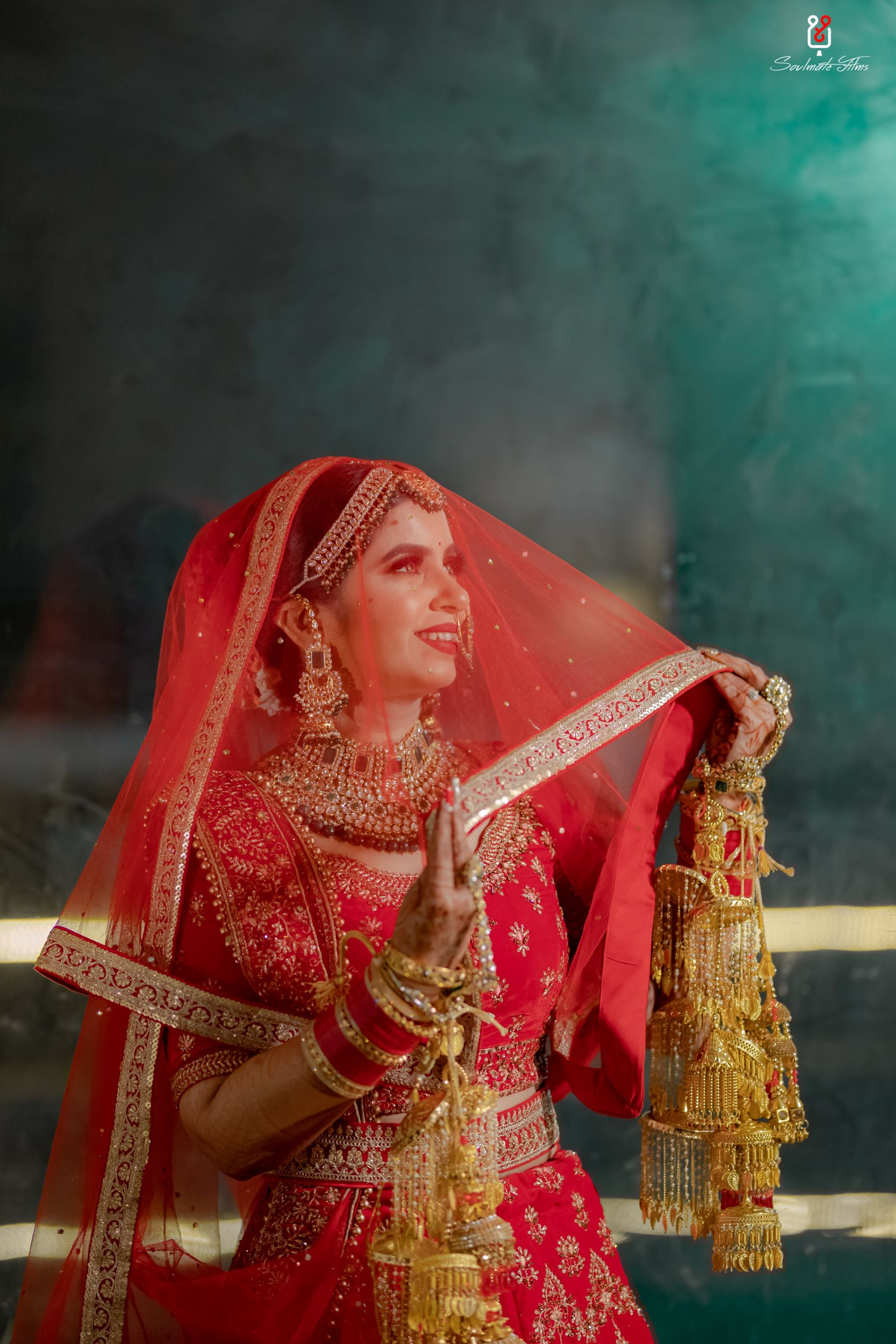 bride in red chooda and gold bridal kalire