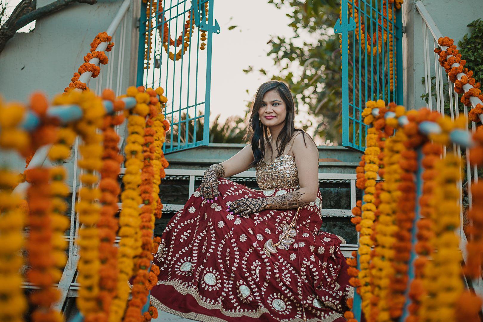 bride in red lehenga for mehendi