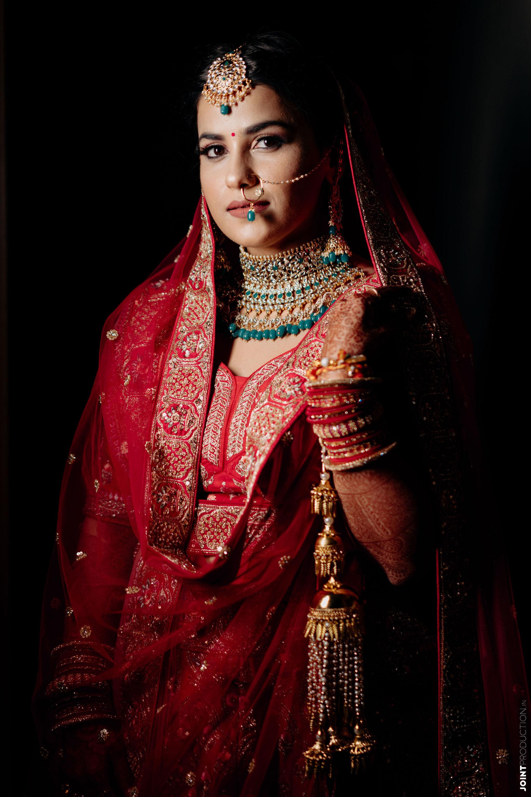bride in red lehenga gold kalire