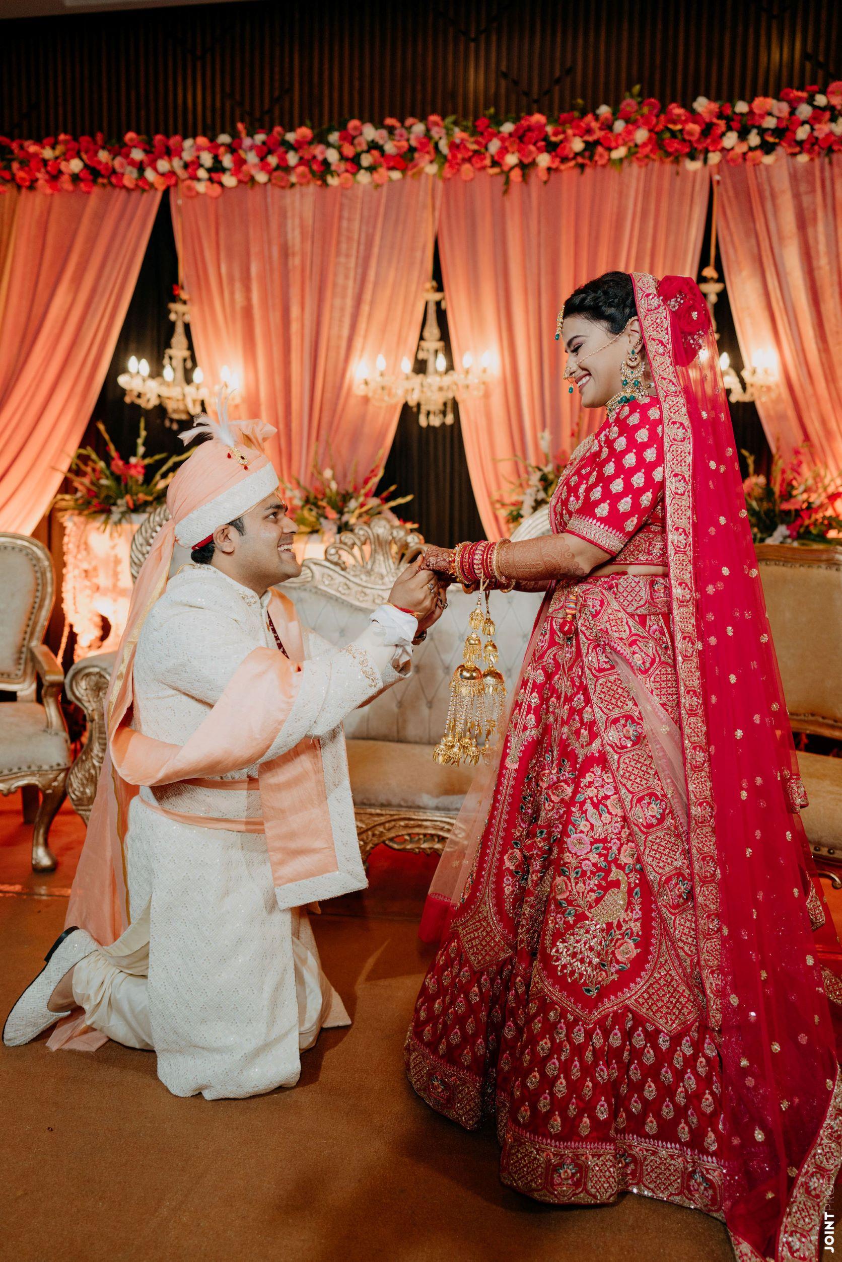 bride in red lehenga groom in white sherwani