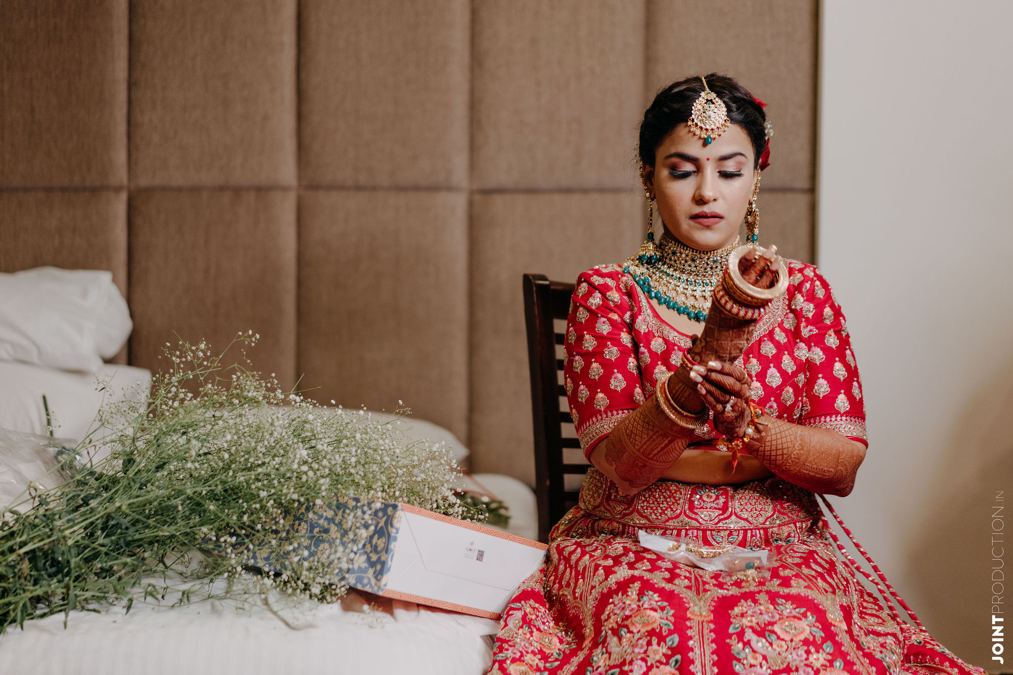 bride in red wearing her bridal bangles