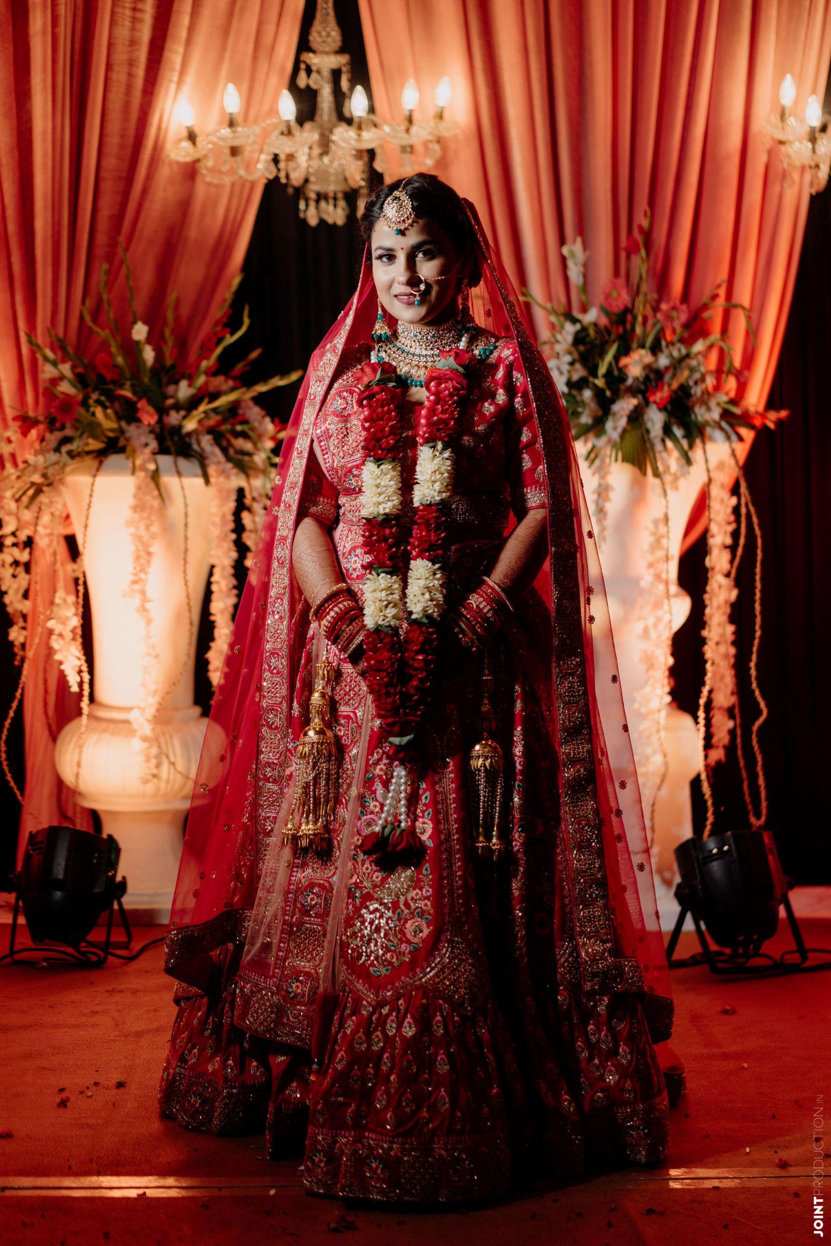 bride in rose jaimala