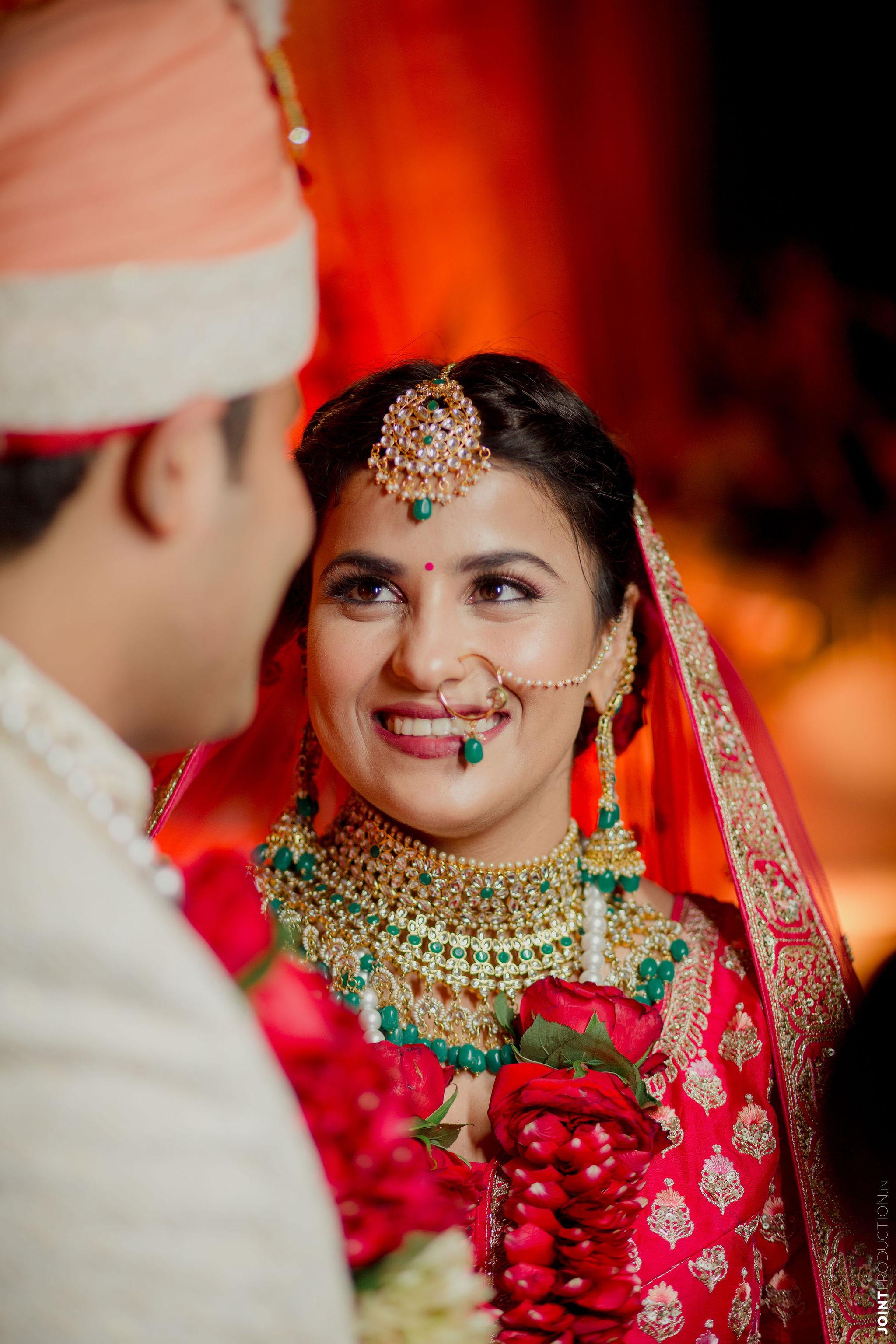 bride in rose jaimala at her wedding