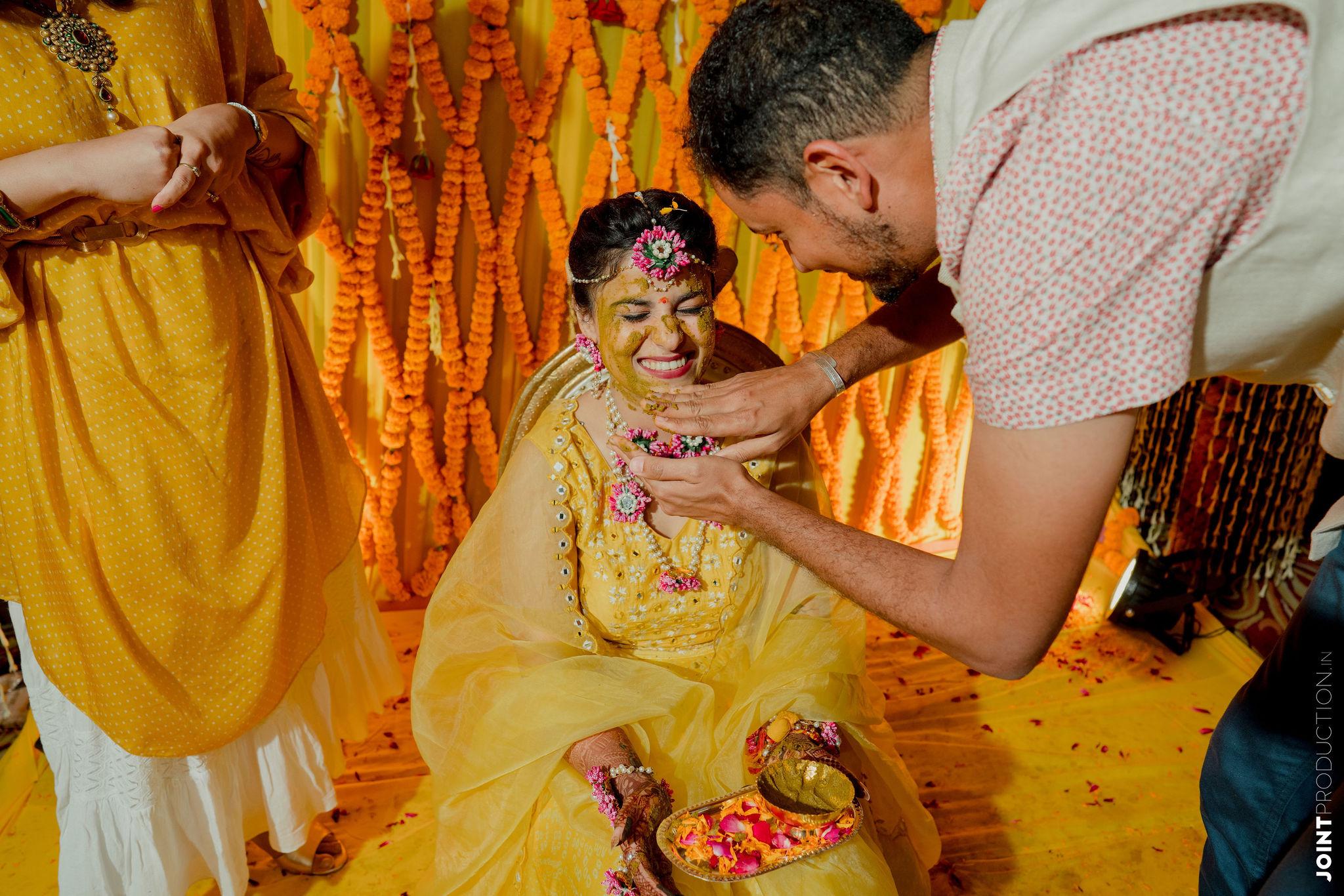 bride in yellow at her haldi