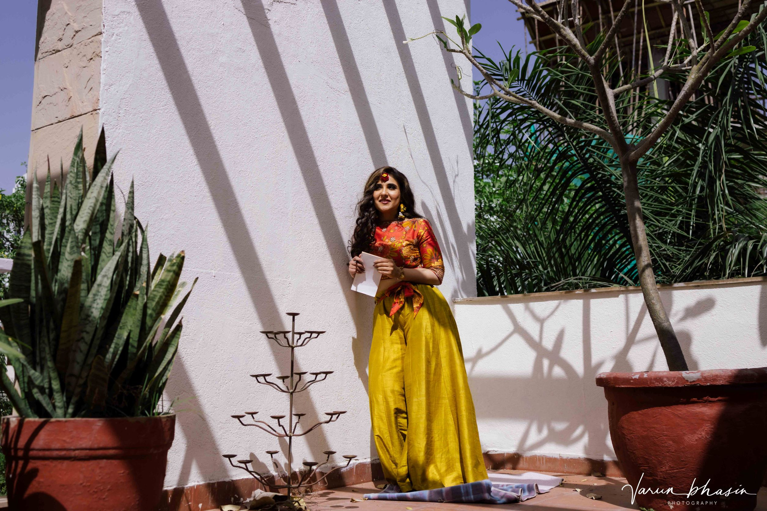 bride in yellow contemporary outfit for mehendi