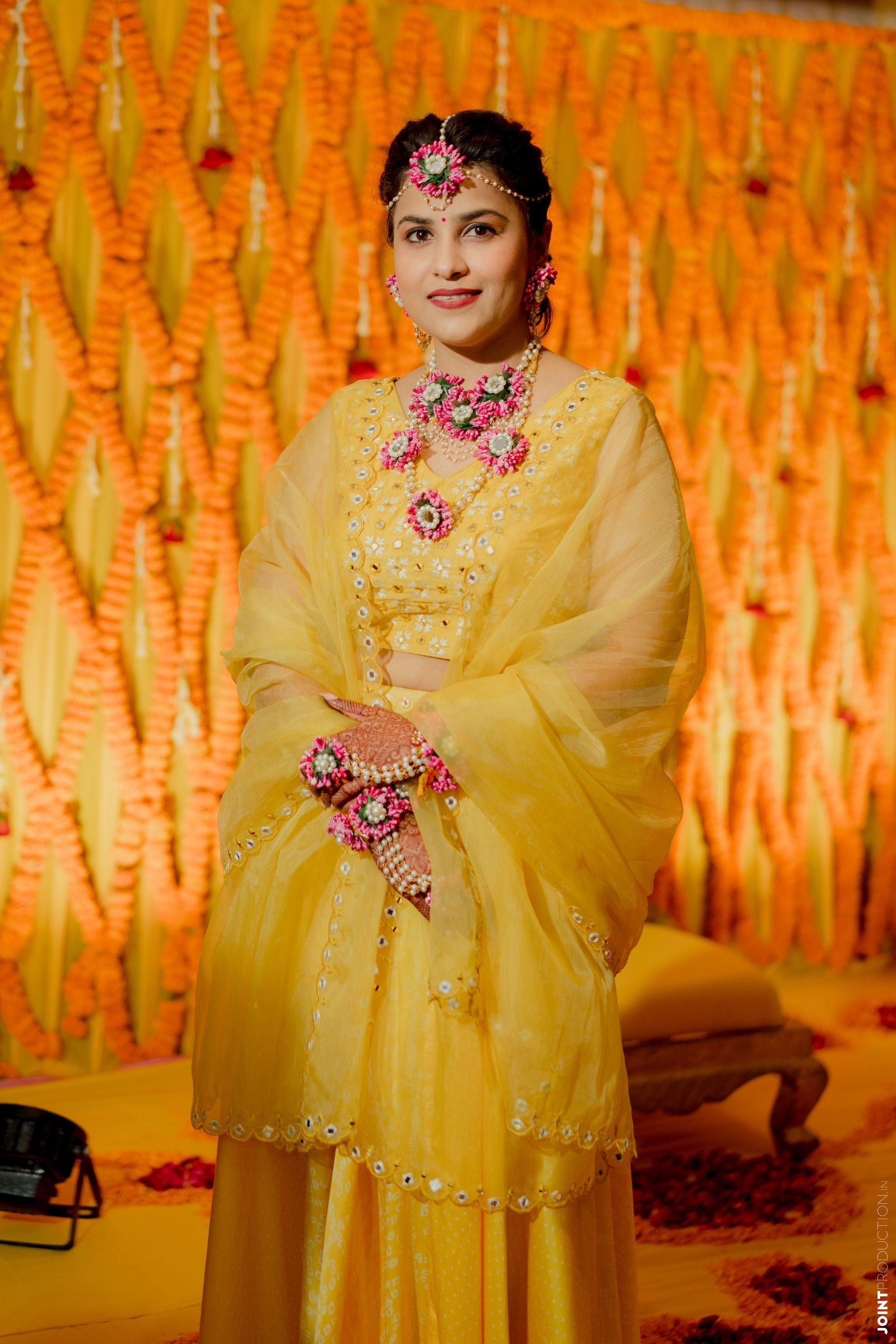 bride in yellow dress for haldi