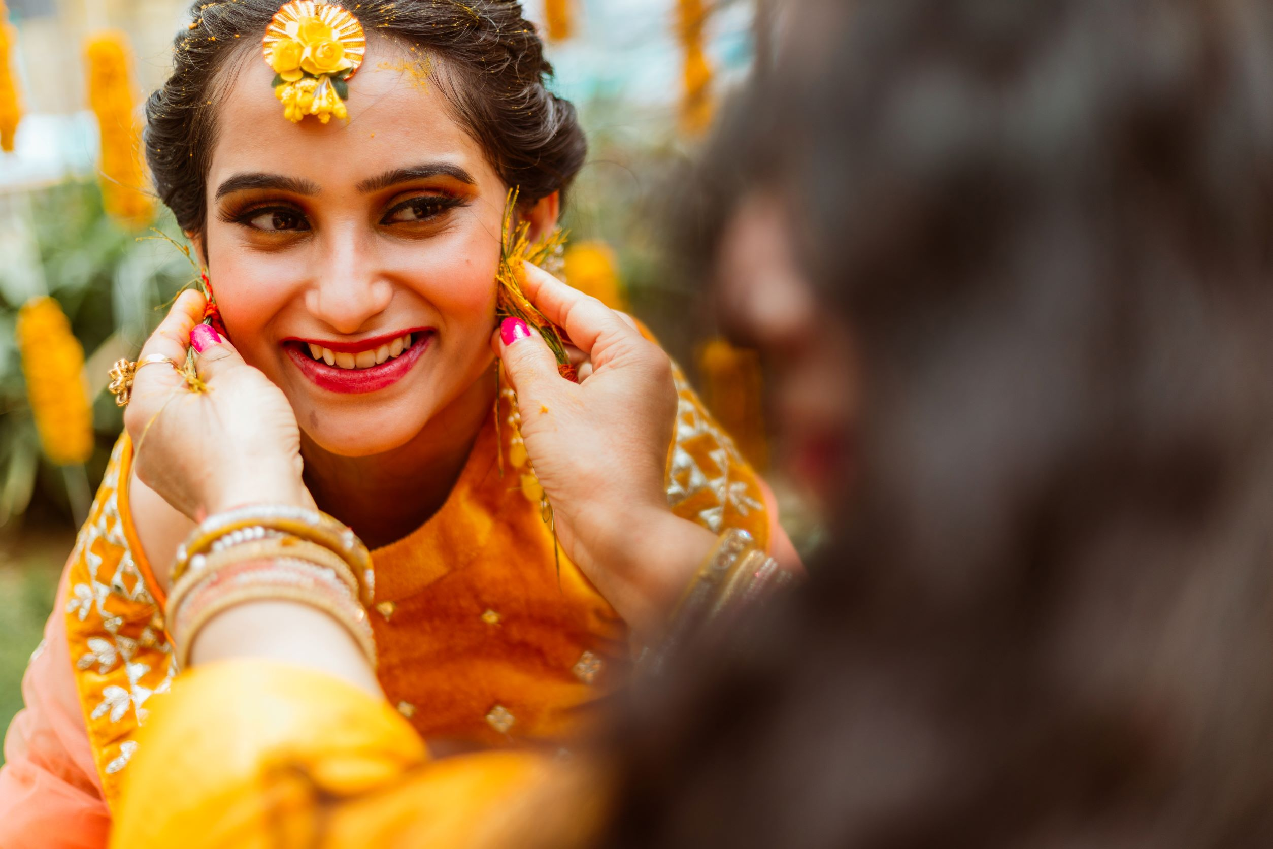 bride in yellow floral jewellery for her haldi