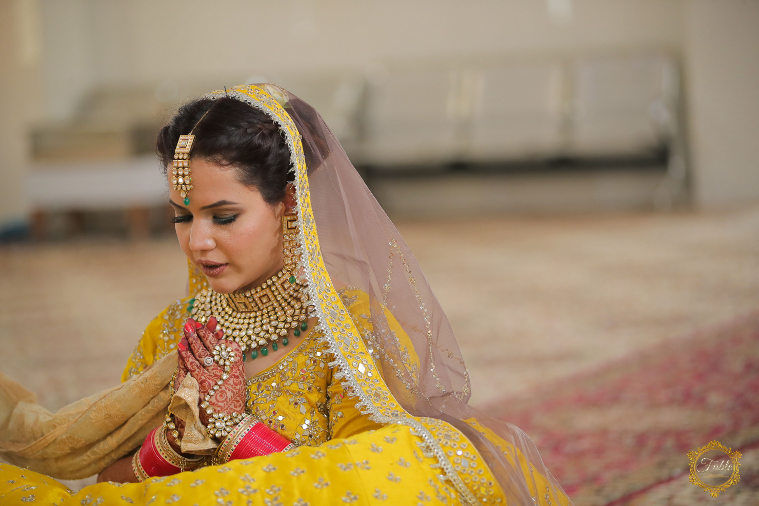 bride in yellow lehenga and contrasting jewellery