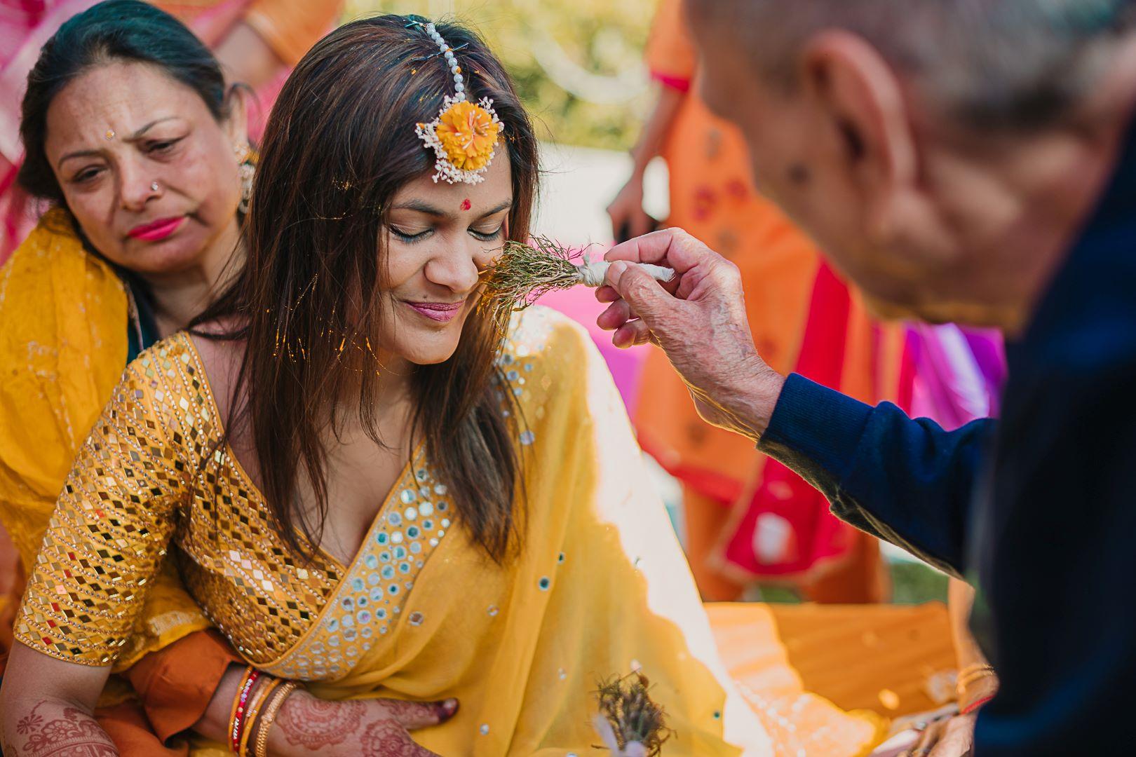 bride in yellow saree for haldi