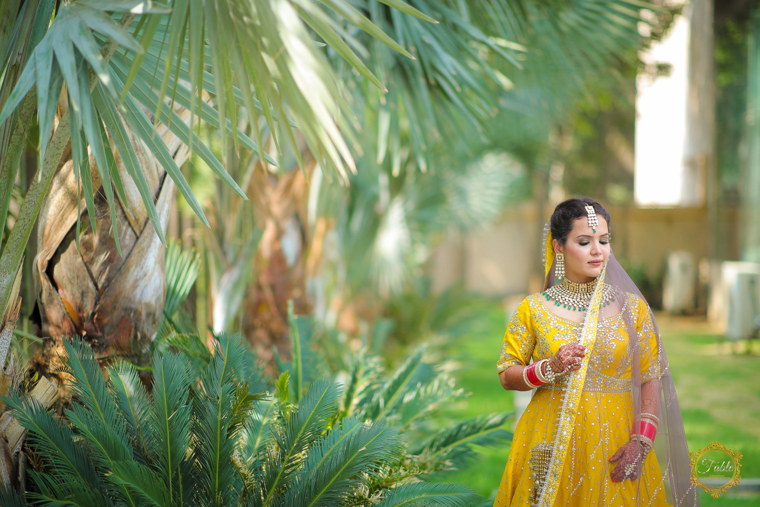 bride poses with her bridal duppatta