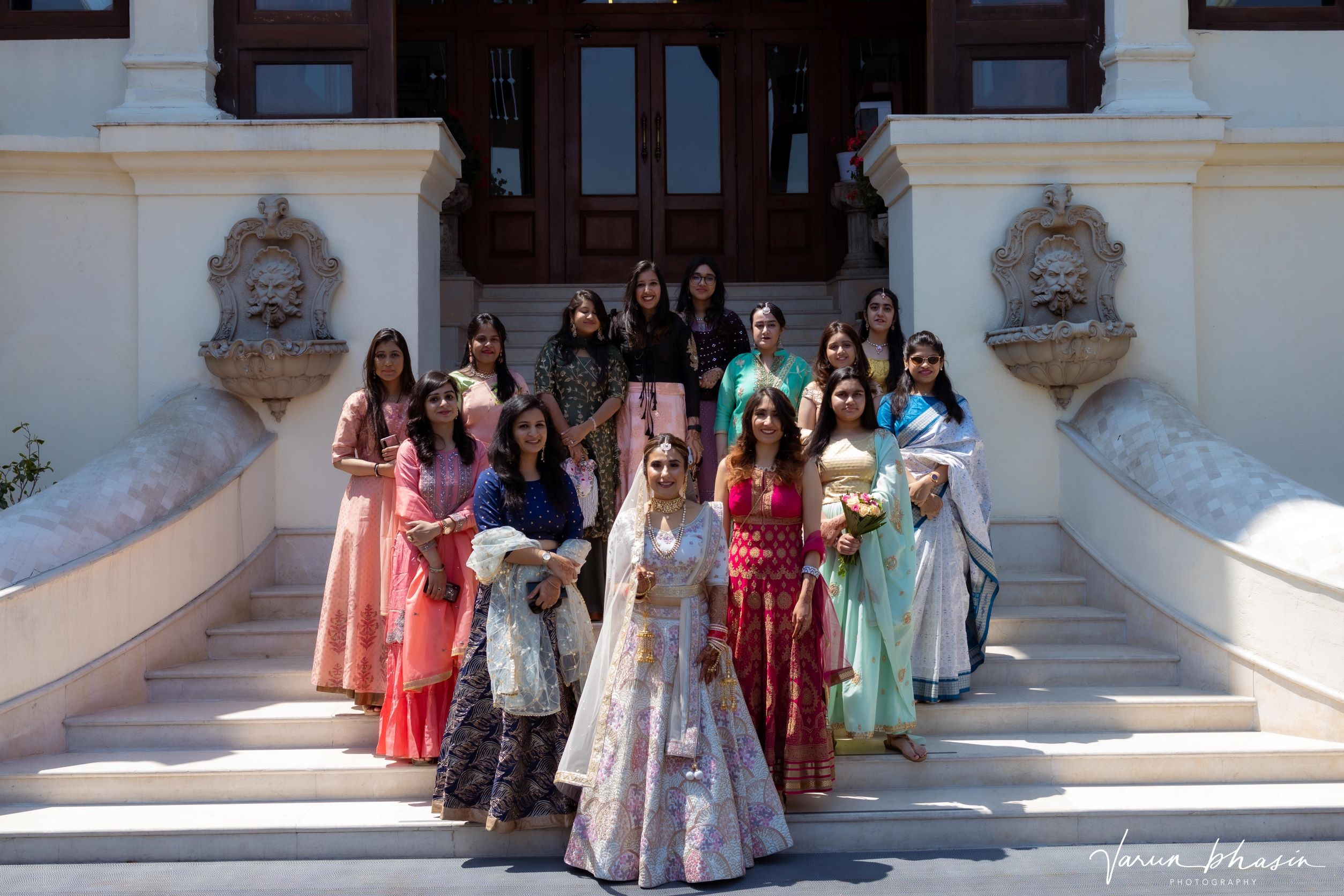 bride poses with her bridesmaids