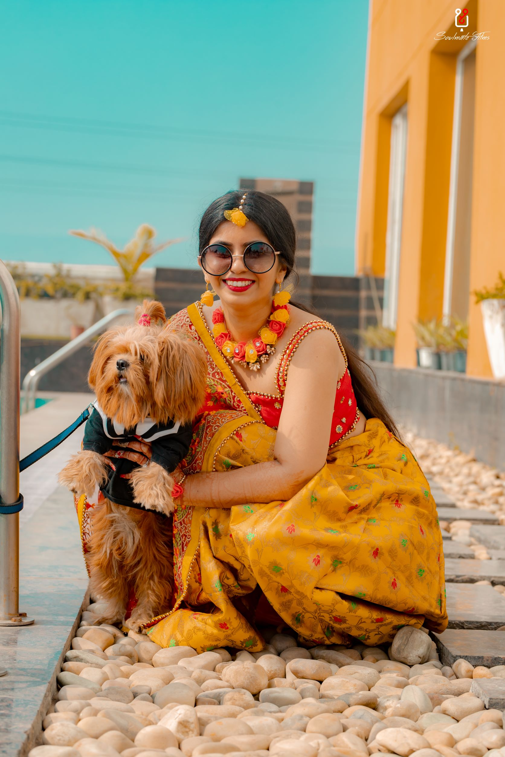 bride poses with her pooch