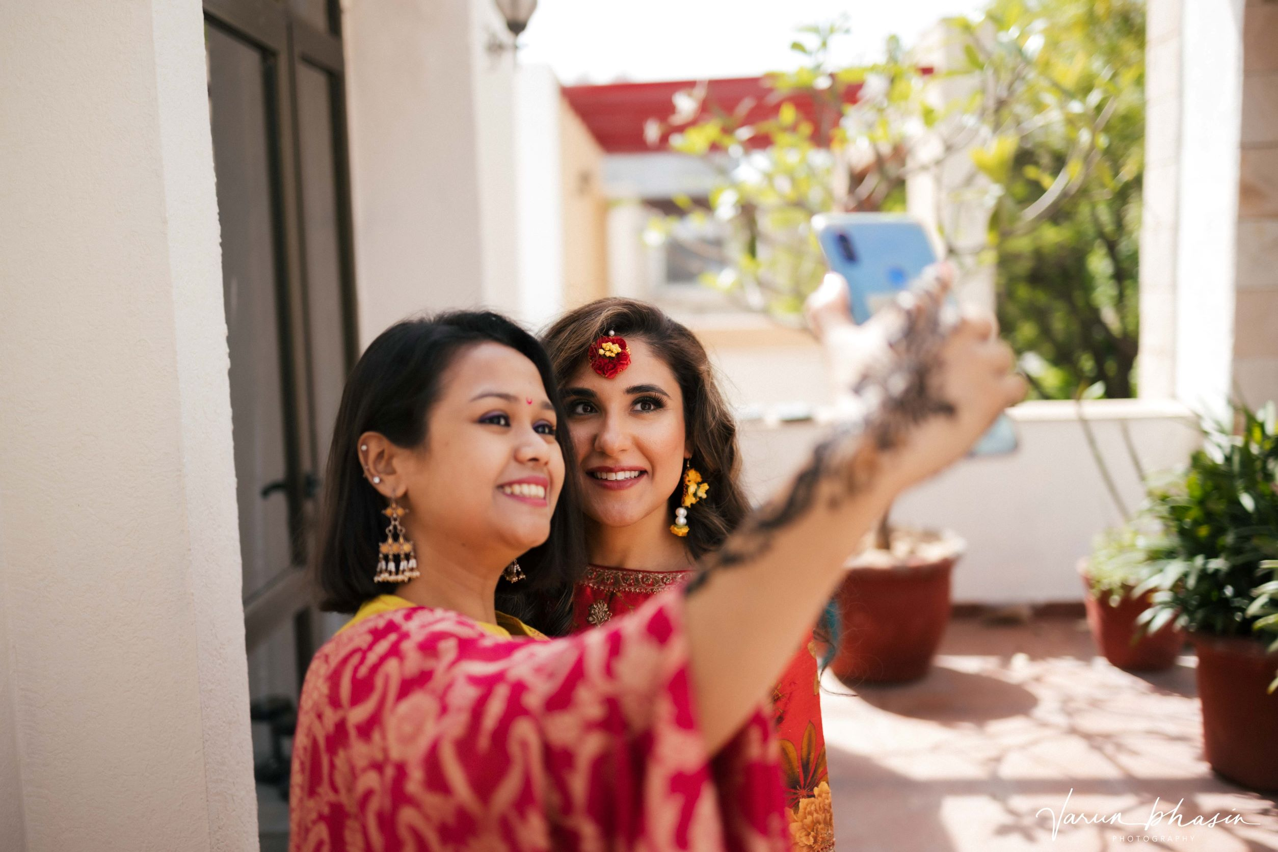 bride takes a selfie with a friend